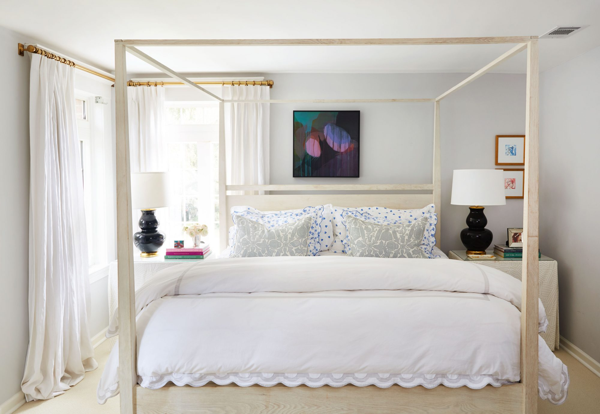 Main Bedroom with light blue walls and four poster bed with white linens