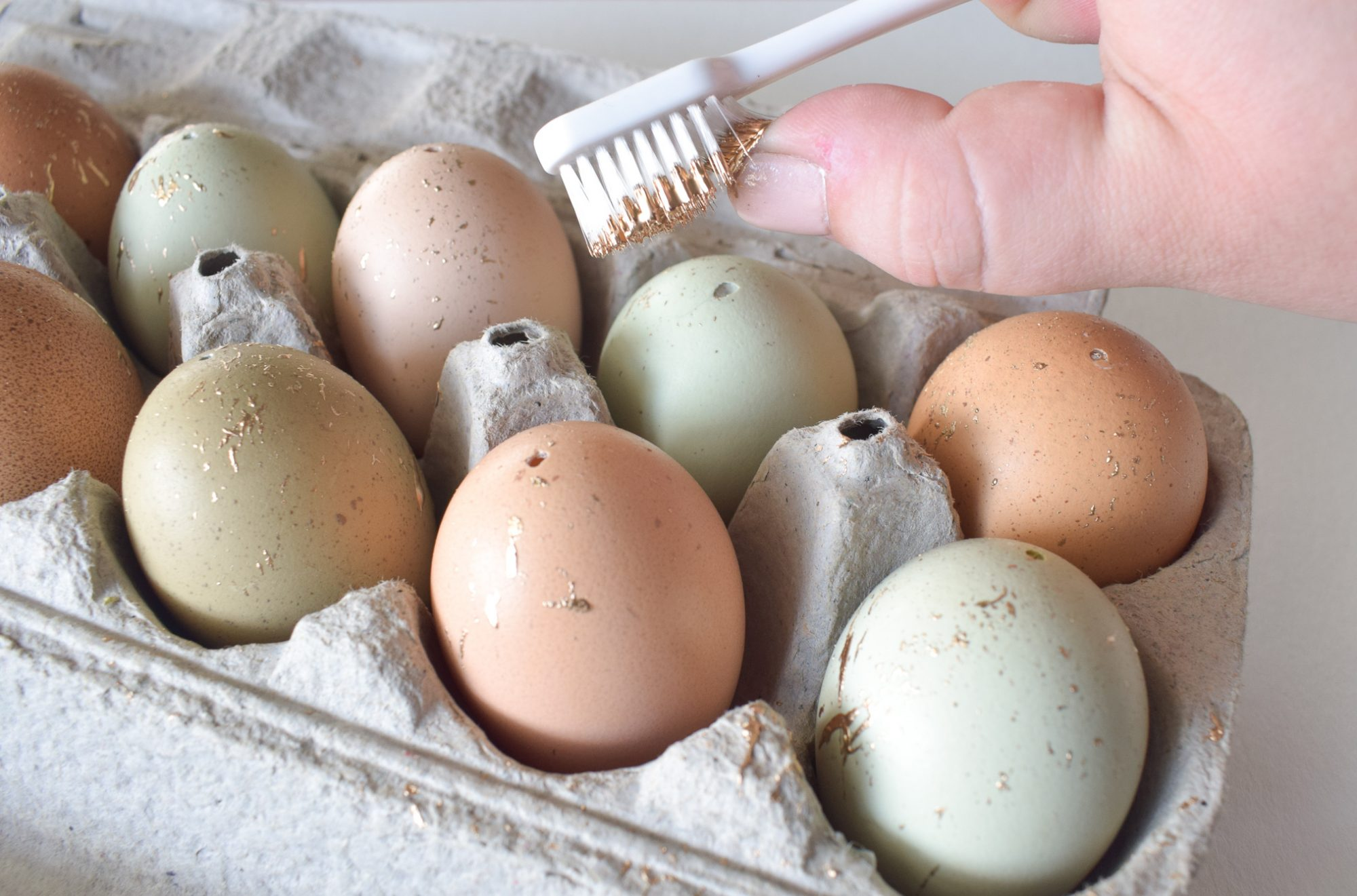 Decorating Eggs with Gold Paint and Toothbrush