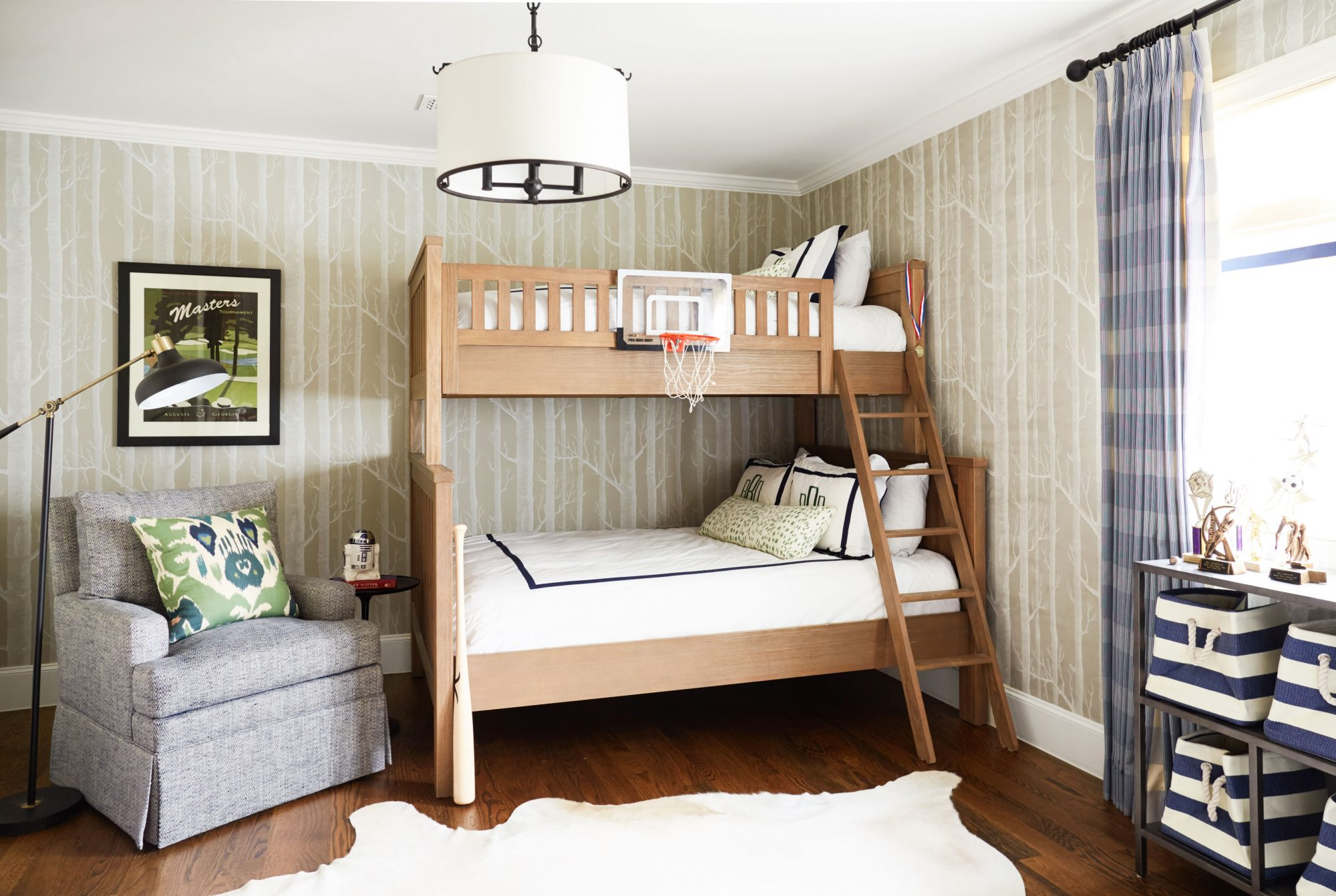 Boy's bedroom with bunkbeds and wood wallpaper