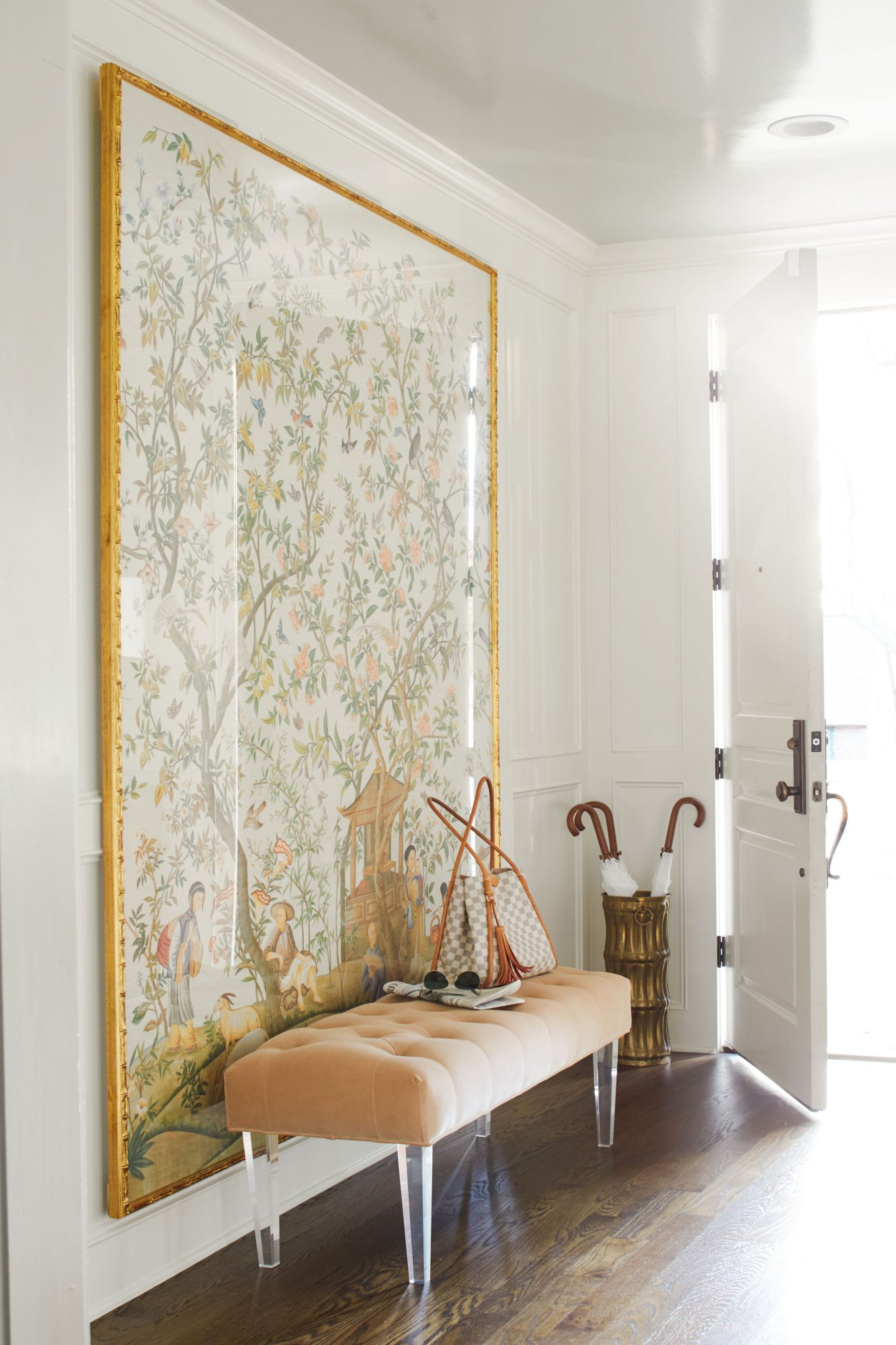 Entry with framed wallpaper panel