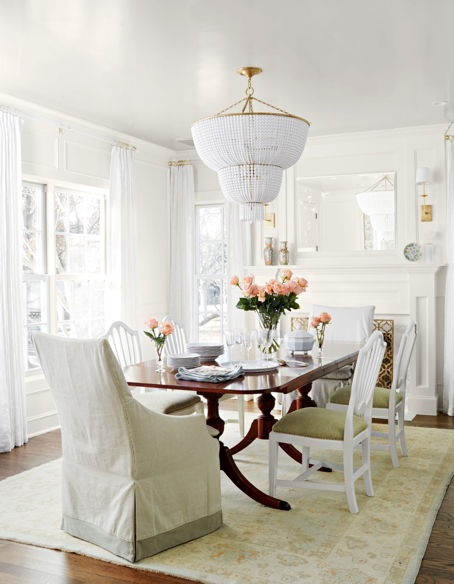 Formal dining room with white walls.