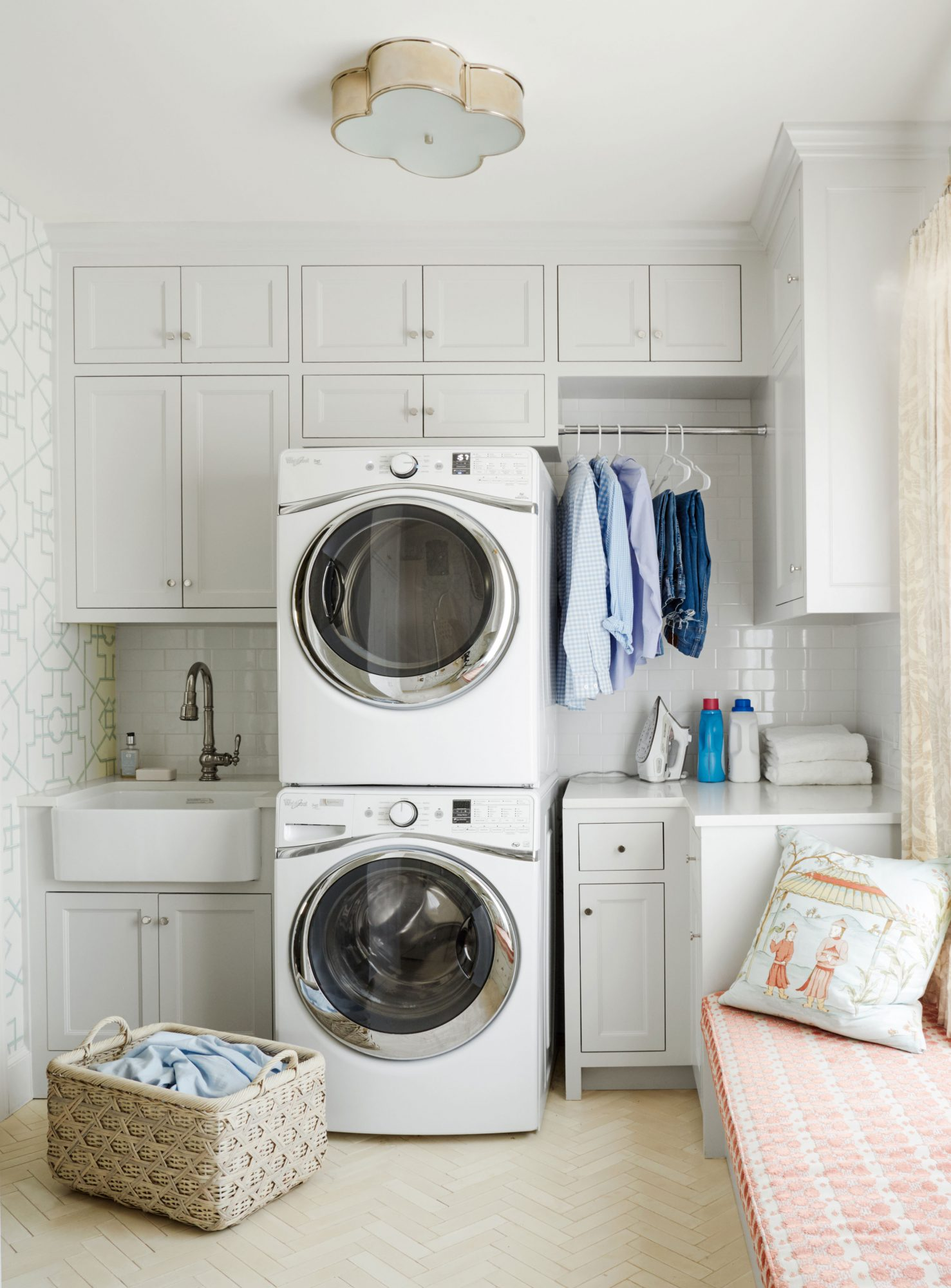 Laundry Room with stacked washer and dryer and shelving