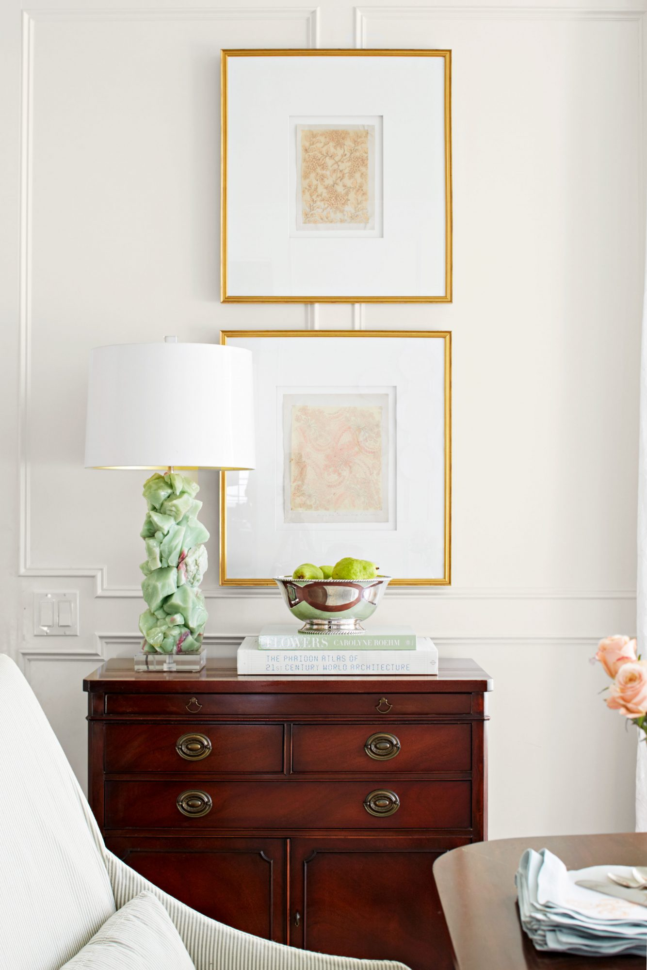Small Sideboard with lamp and art in formal dining room