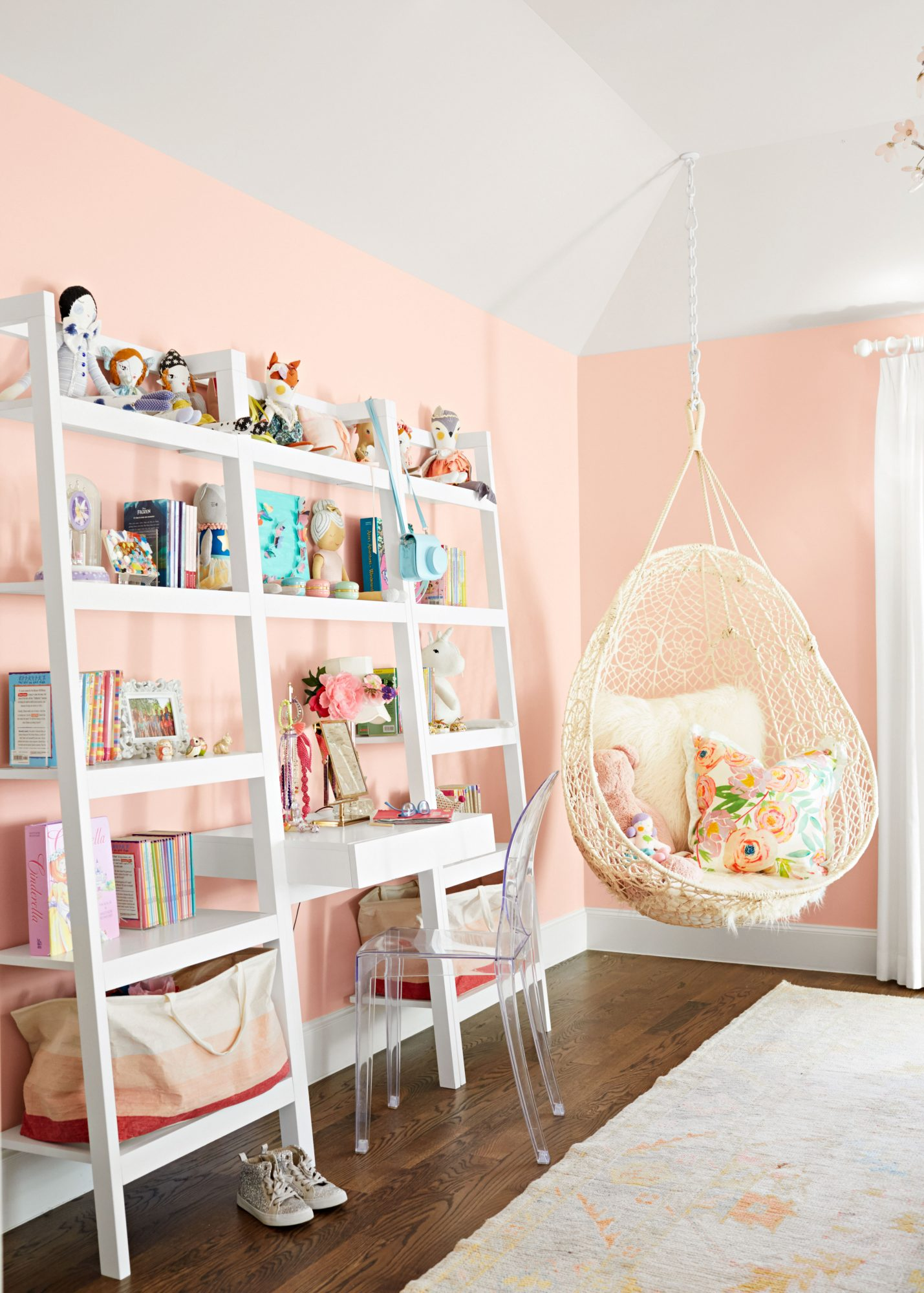Pink bedroom with open shelves and desk