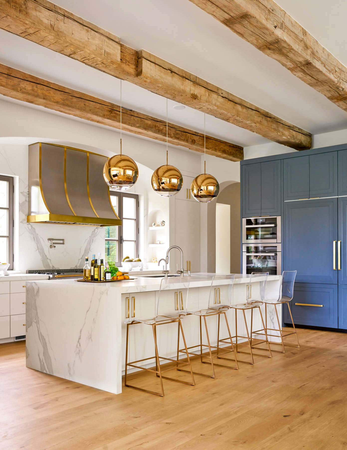 Kitchen with Waterfall Marble Island and Walls in Outerspace by Sherwin Williams