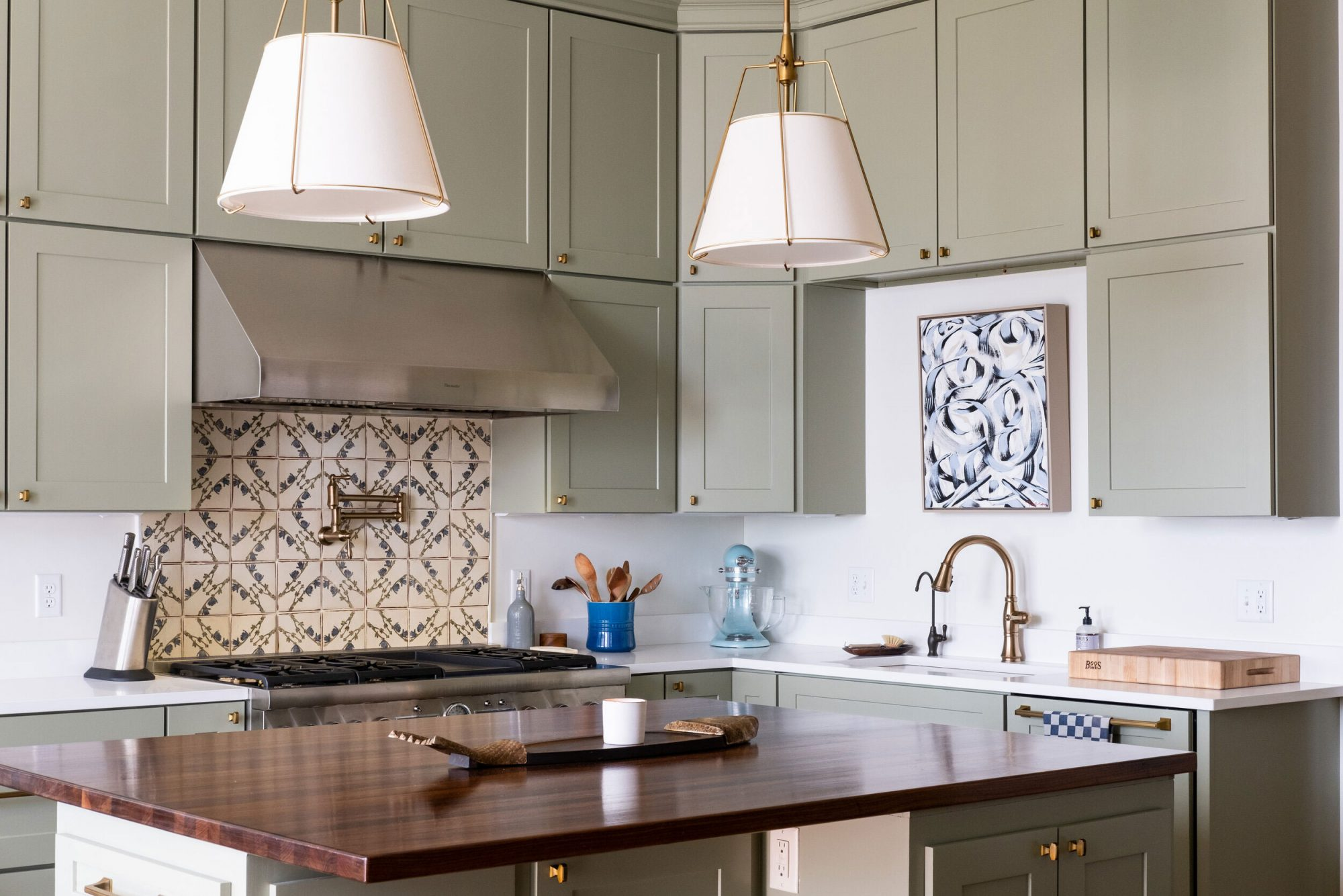 Kitchen with Patterned Backsplash and Cabinets Painted Green Earth By Sherwin Williams