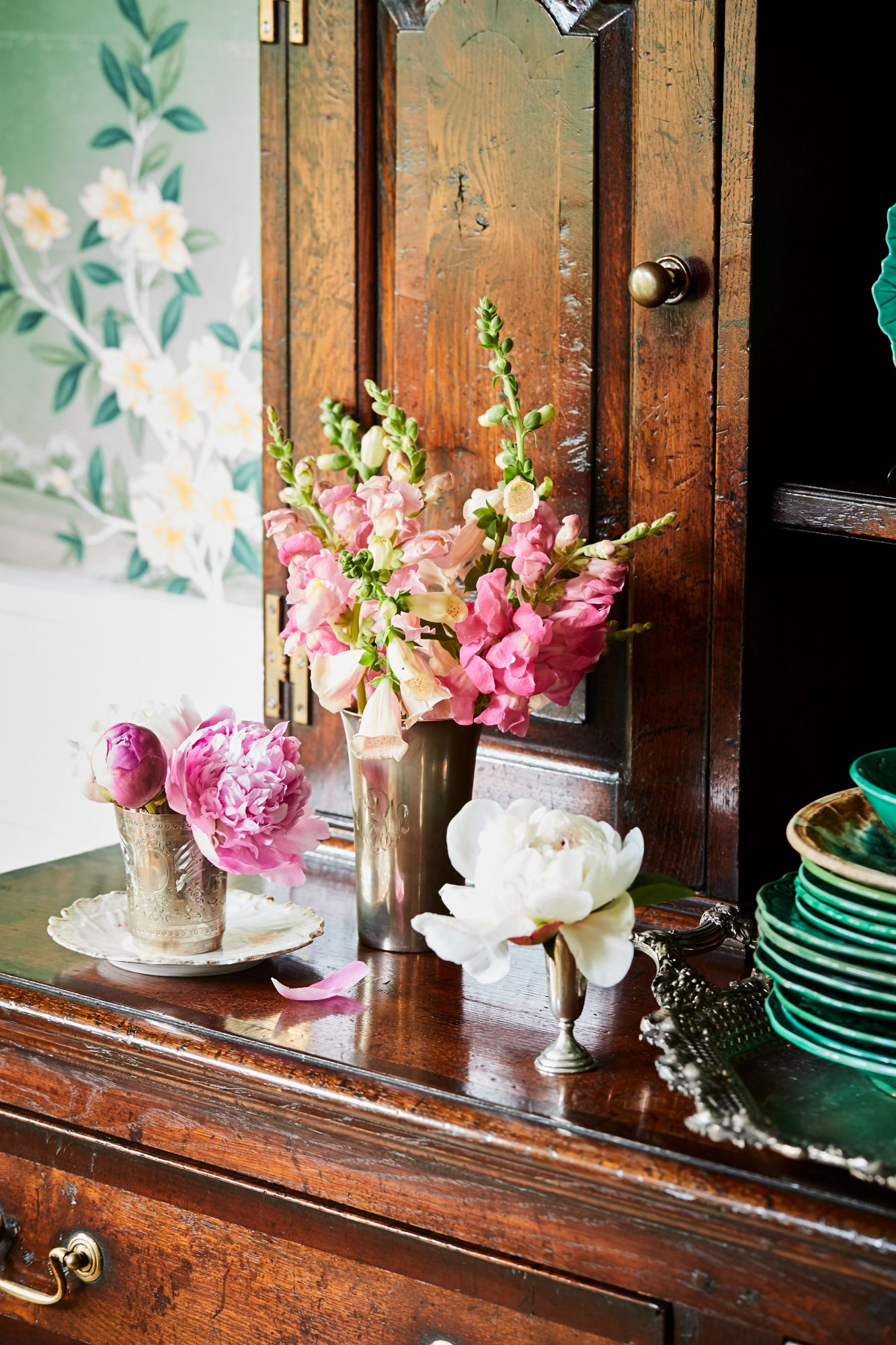 Peony, Foxglove, and Snapdragons arranged in silver containers