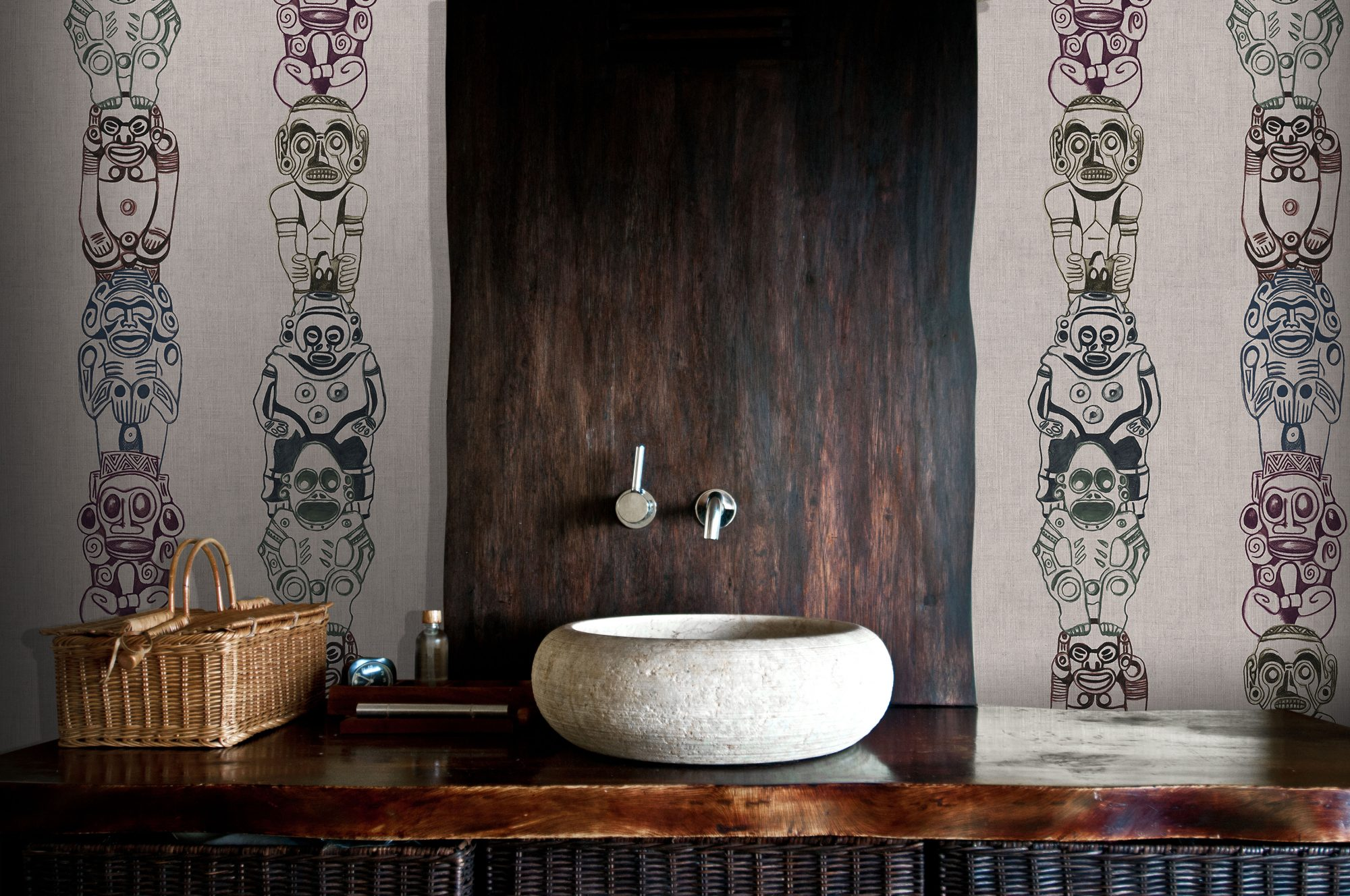 Stone Sink with Wallpaper on Wall Behind