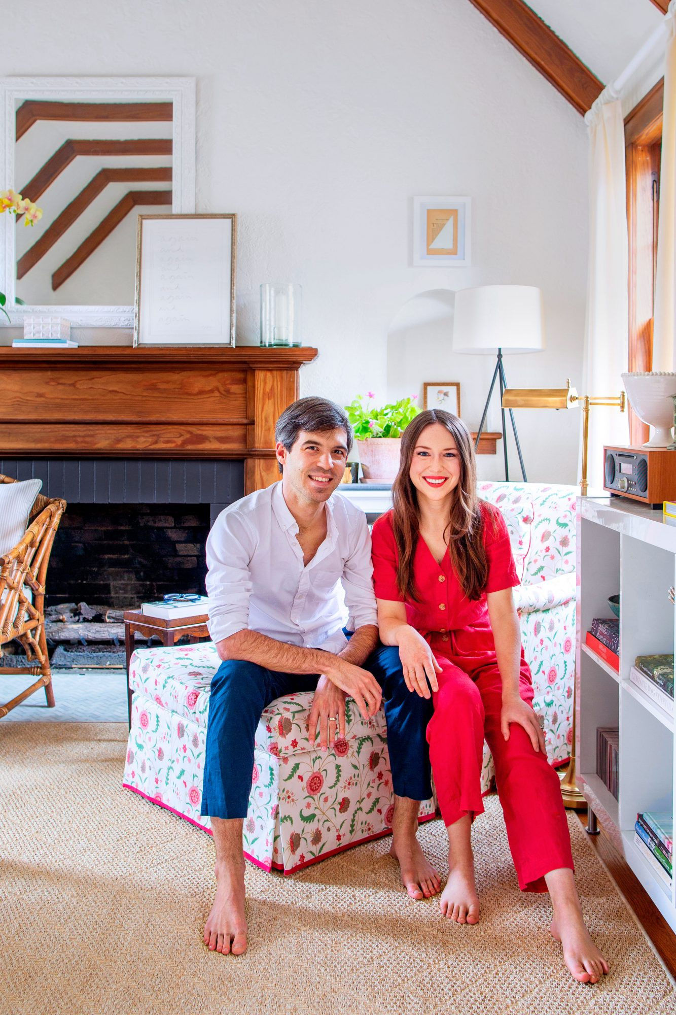 Adam and Amber Ford of The Happy Tudor blog in their living room