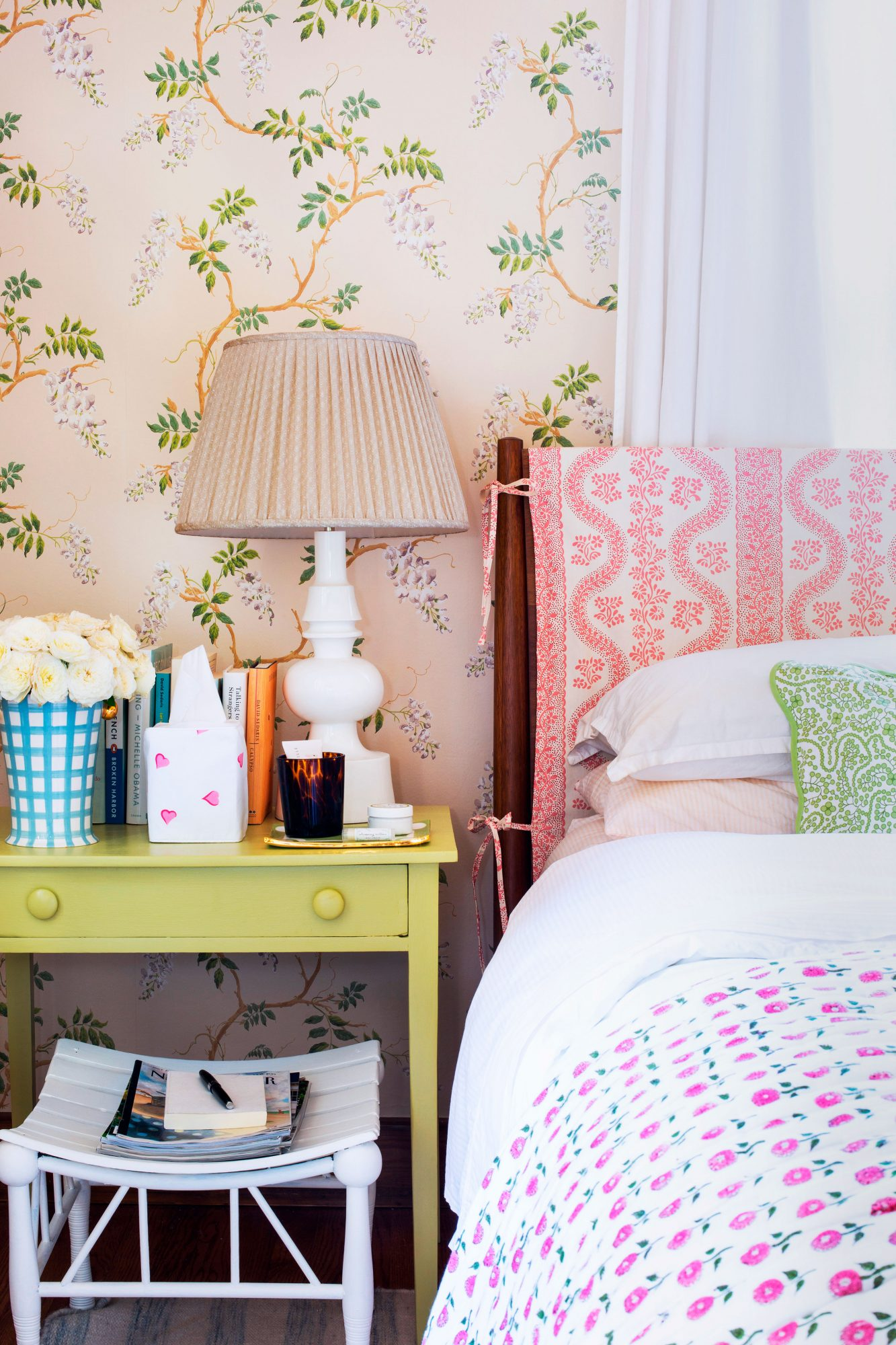 Pink themed bedroom with wallpapered walls