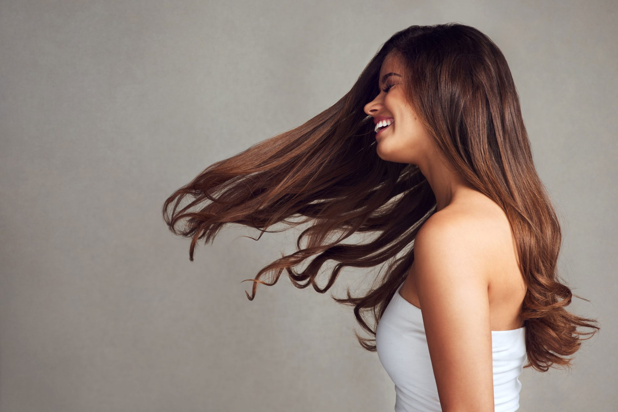 Woman with Long Brown Hair Loose Waves Smiling