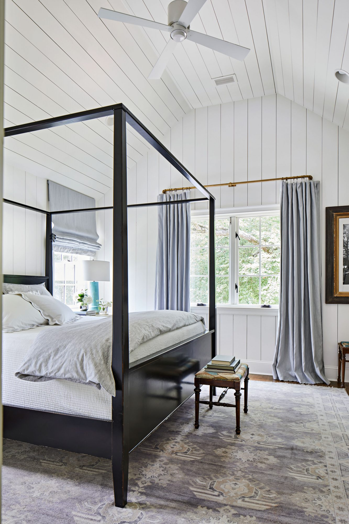 White and gray main bedroom