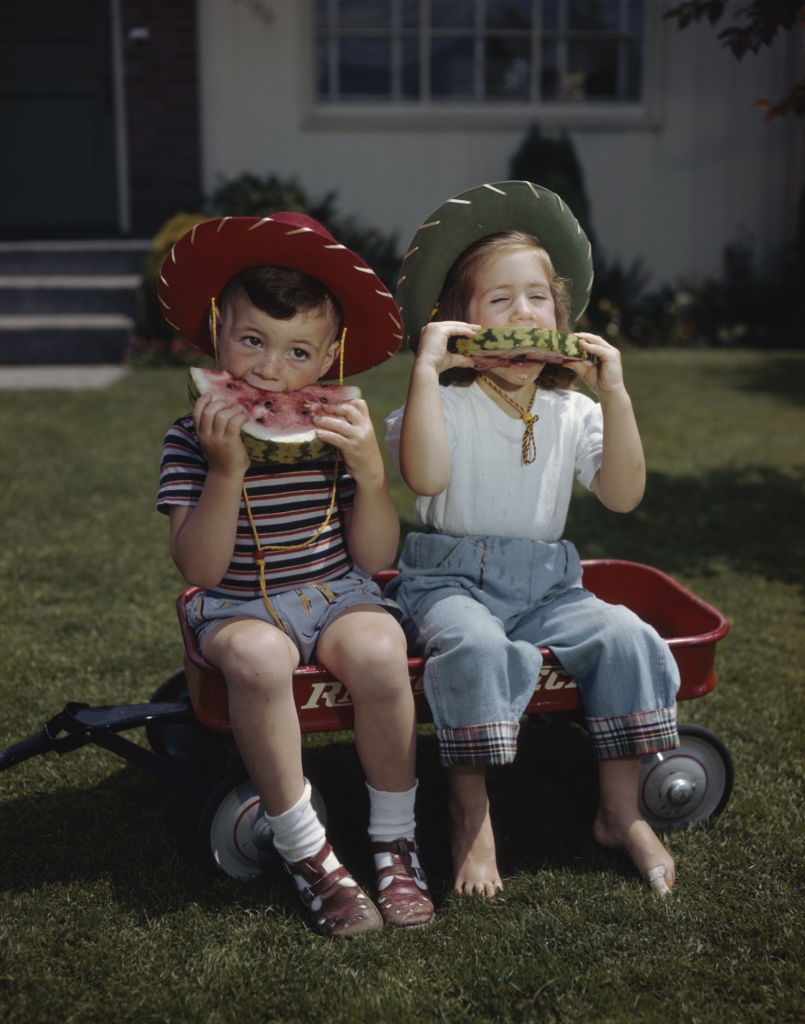 Kids Eating Slices of Watermelon