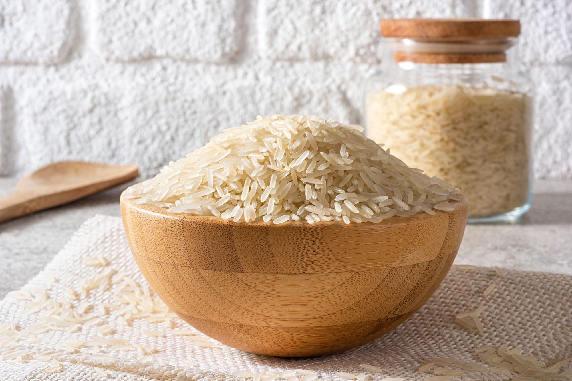 Uncooked Jasmin Rice in Wood Bowl