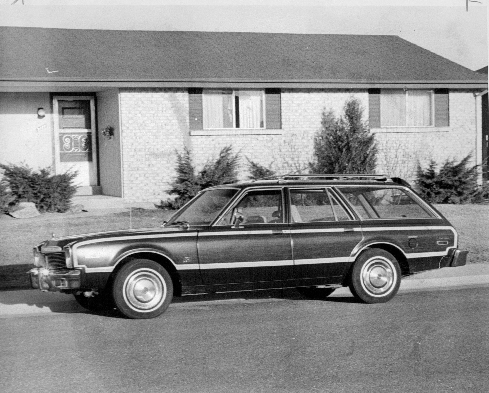 Vintage station wagon in front of house