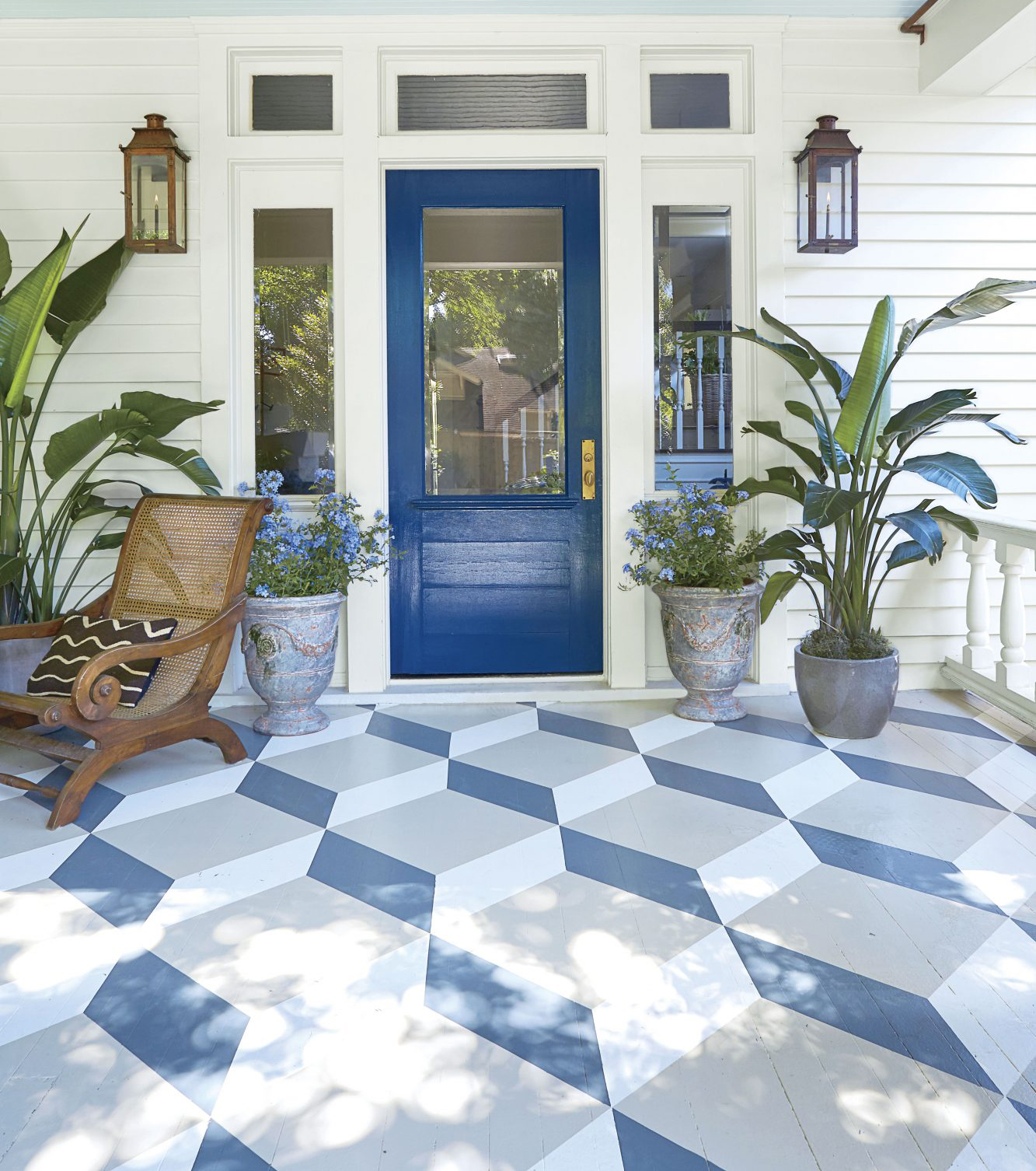 Front Porch with Patterned Painted Floor and Navy Front Door
