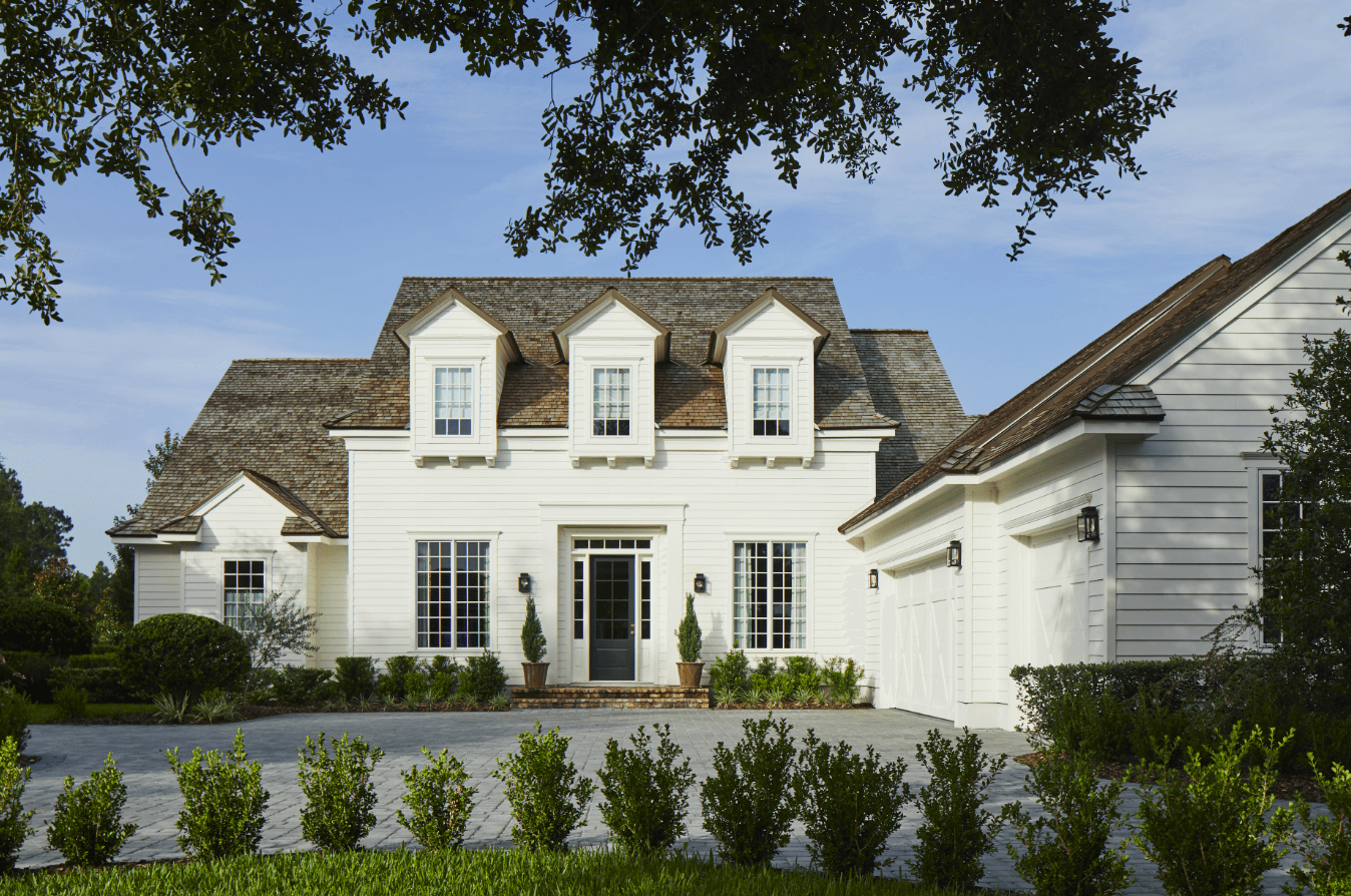 """Chateau-inspired house with front door painted in Benjamin Moore """"Almost Black"""""""