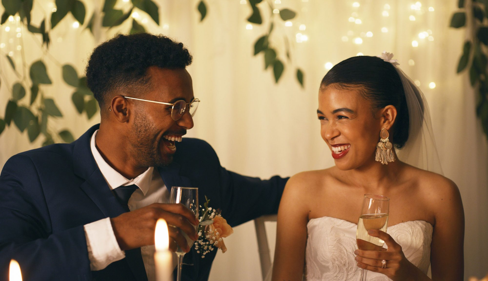 Bride and Groom Smiling During Wedding Toast