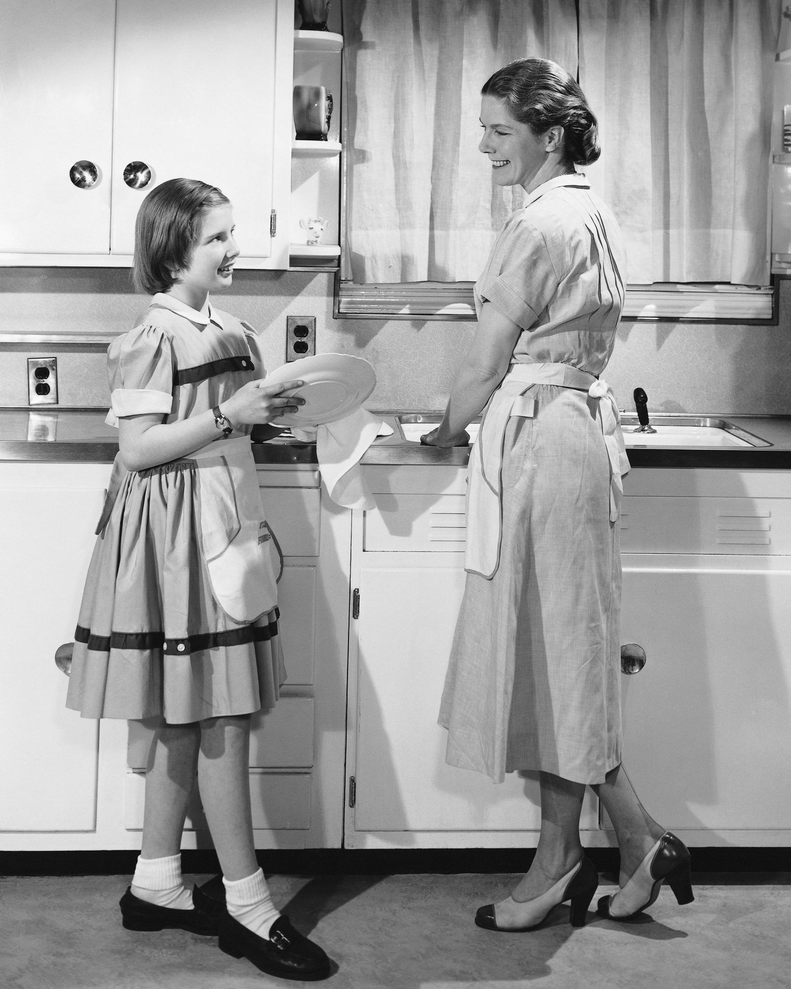 Vintage Woman and Daughter Washing Dishes