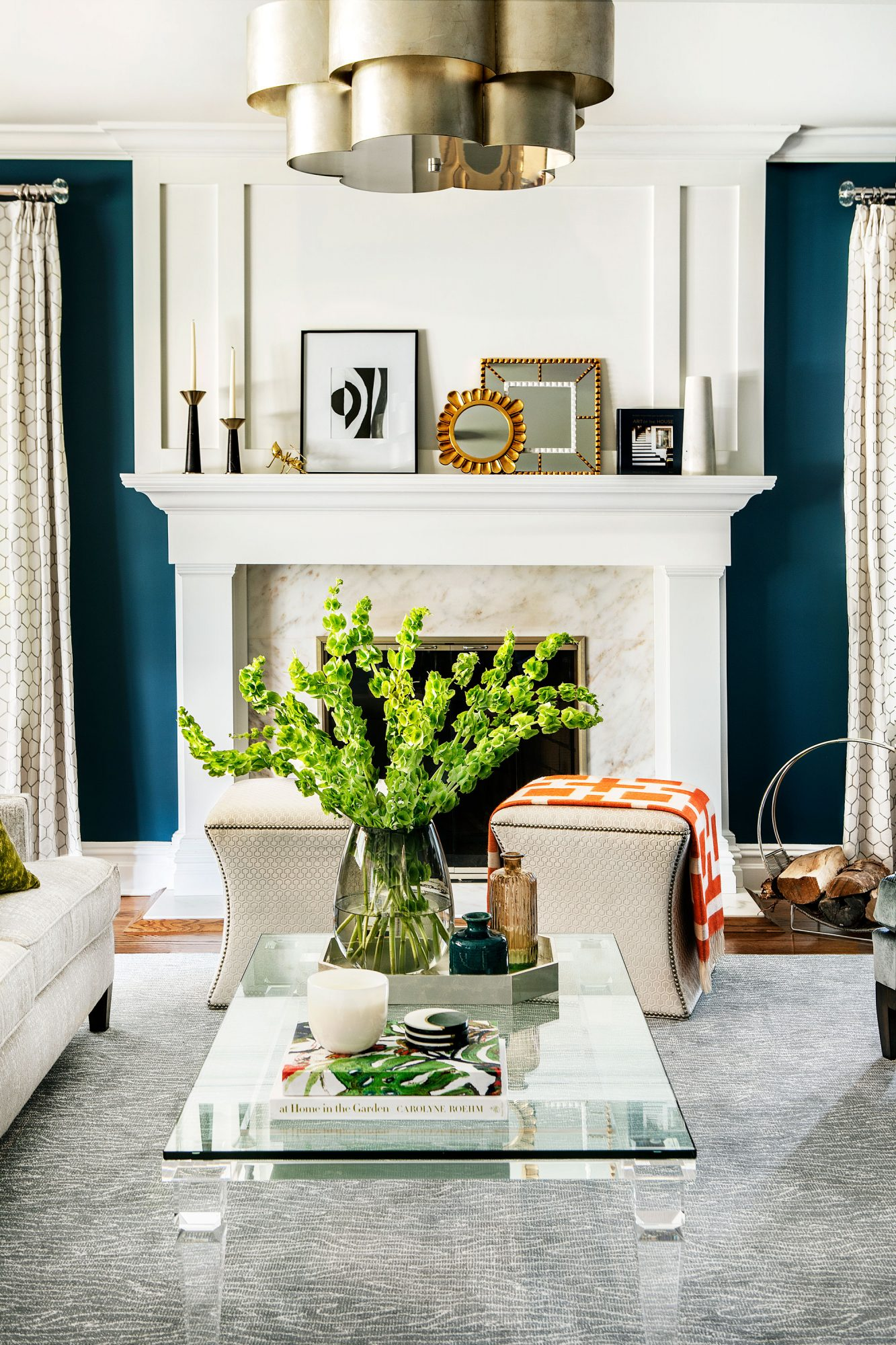 Living Room with White Fireplace and Large Green Plant on the White Coffee Table