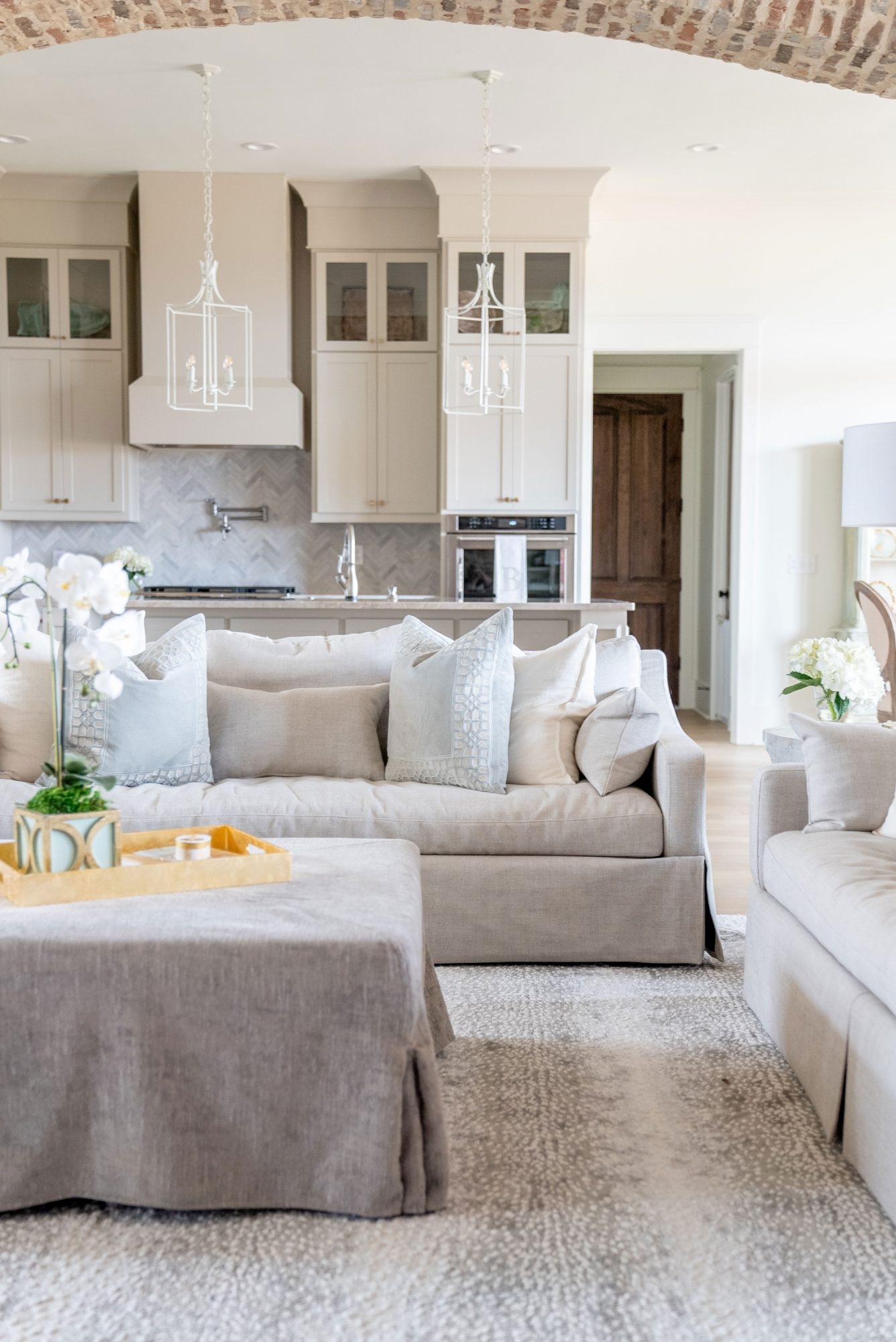 Open Living Room and Kitchen Beige Cabinets