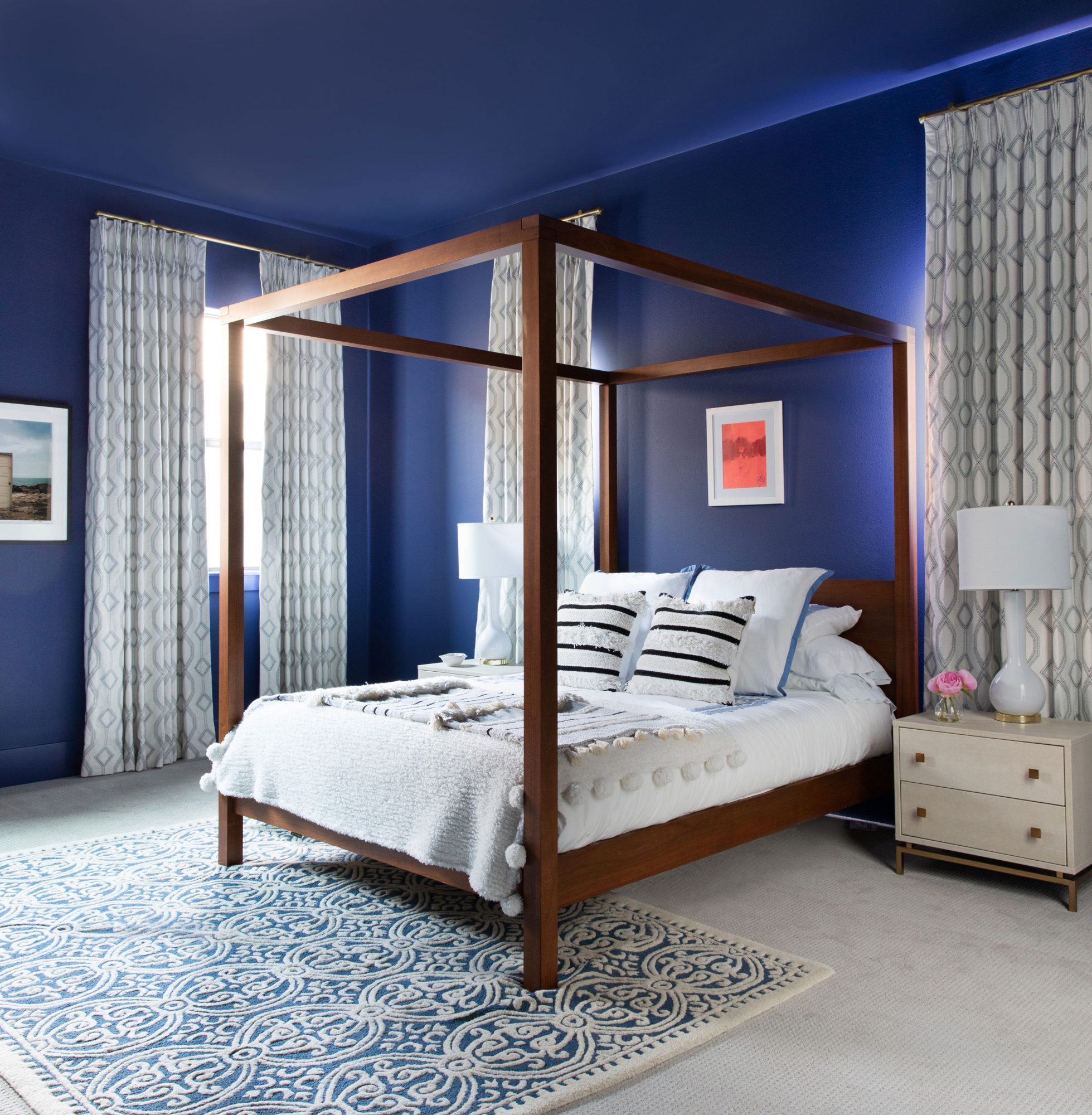 Four-poster bed in a deep blue room
