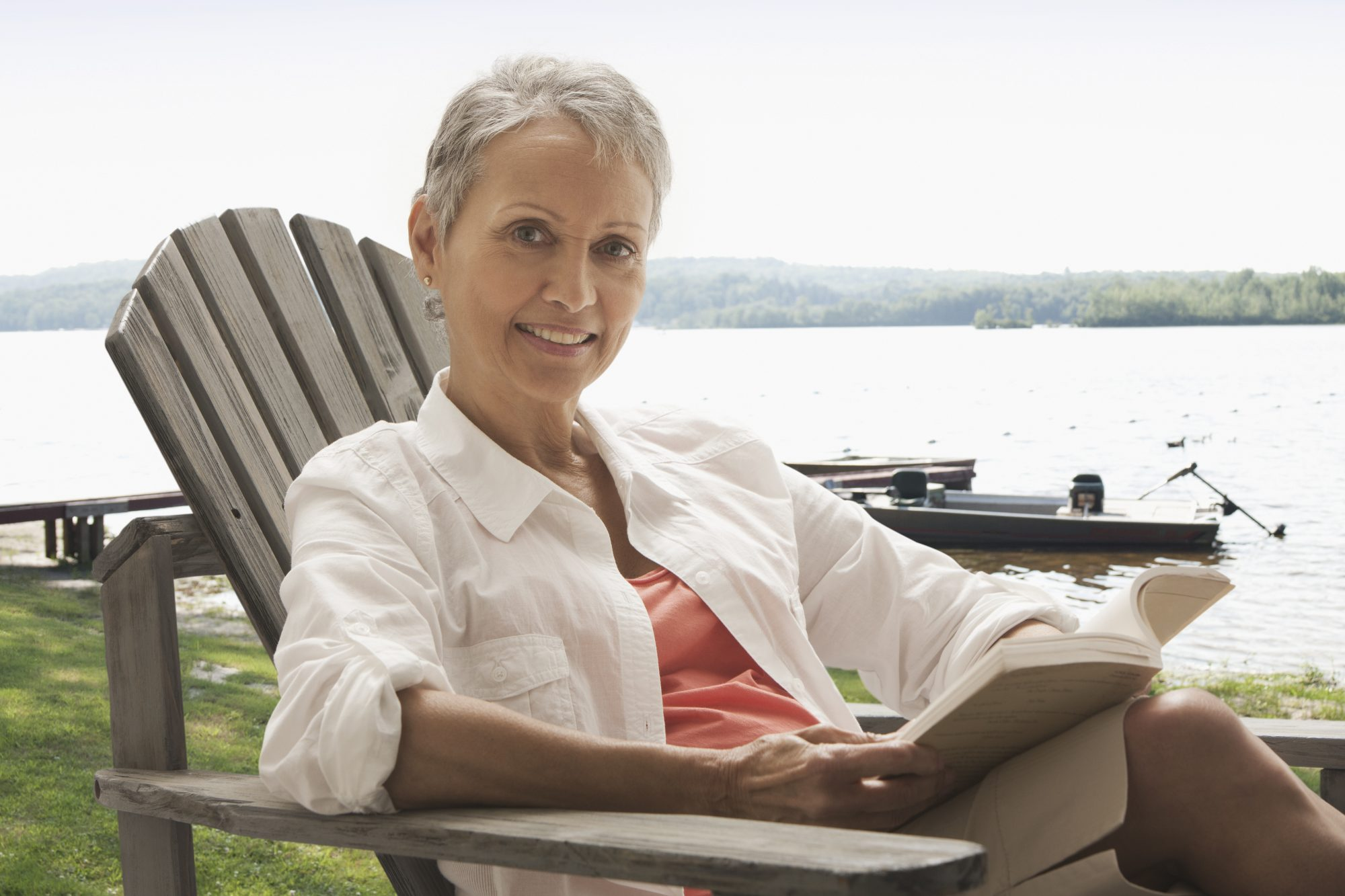 Woman sitting outdoor reading book
