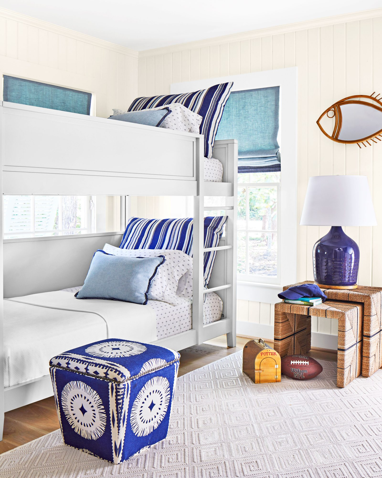 Coastal kids' bedroom with blue and white details
