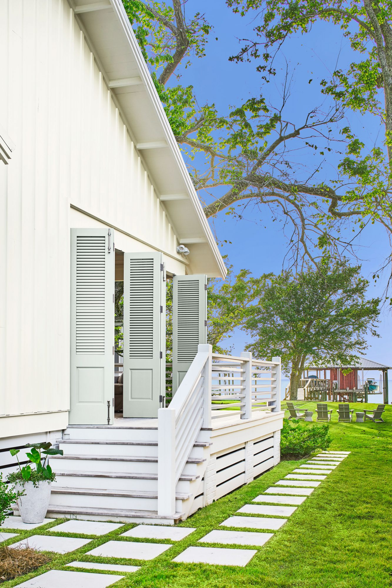 Coastal cottage exterior with shutter doors