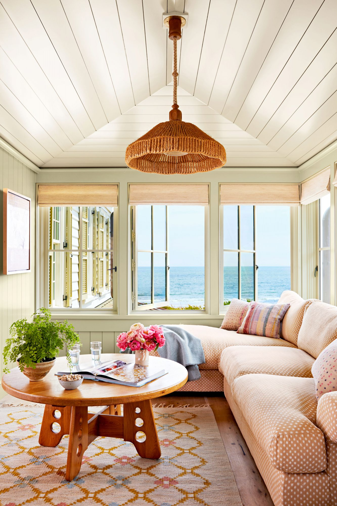 Cozy den with patterned sofa and ocean view