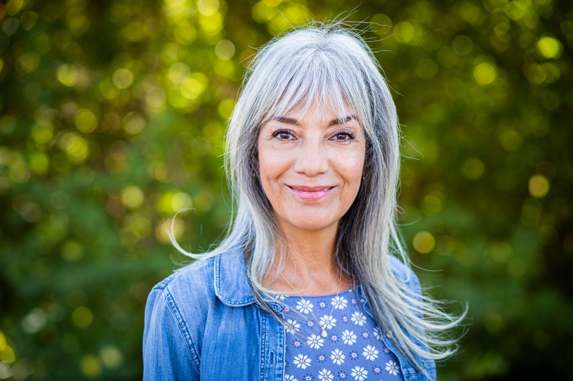 Woman with Gray Hair and Bangs Smiling