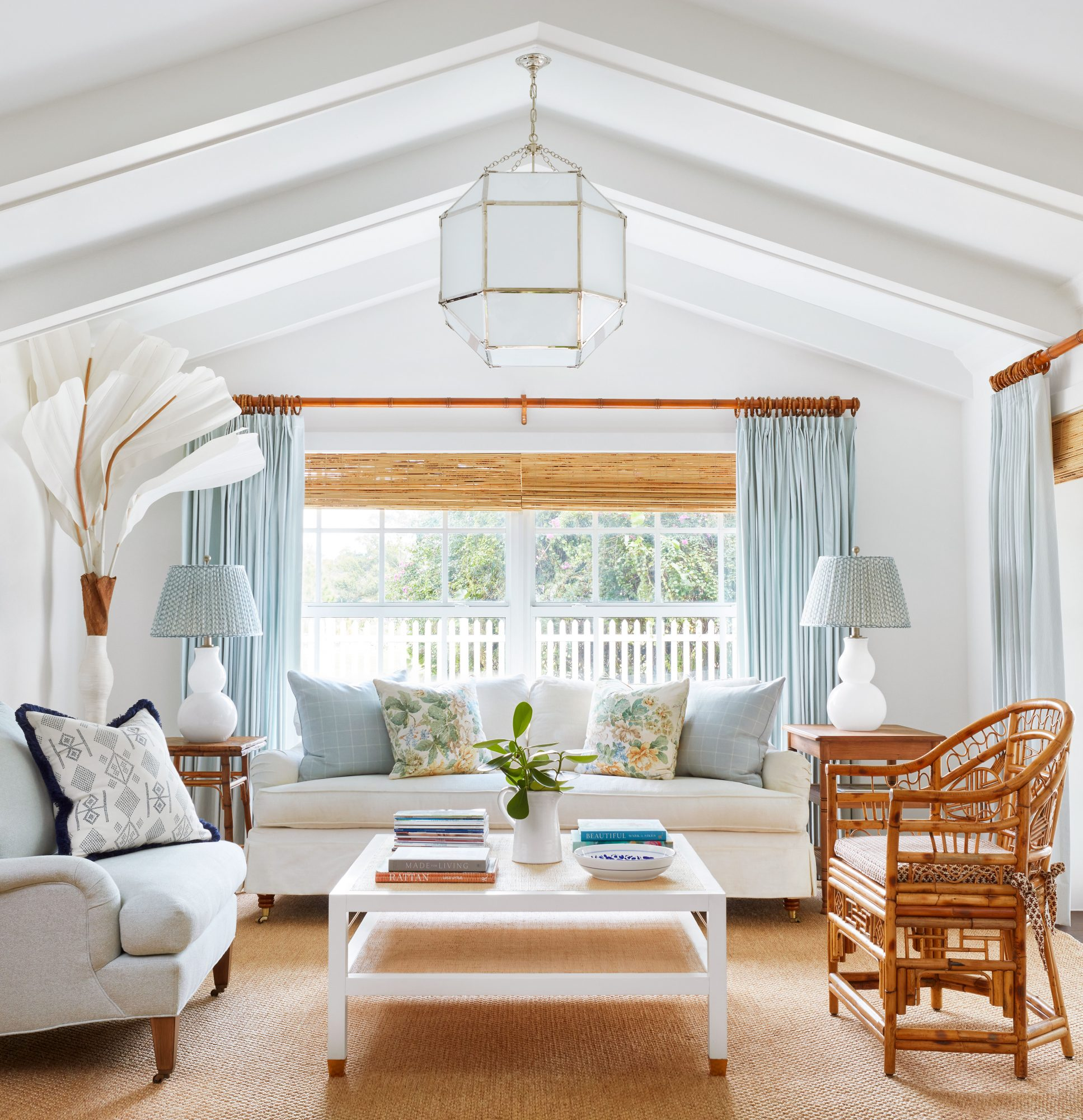 Coastal white living room with blue accents
