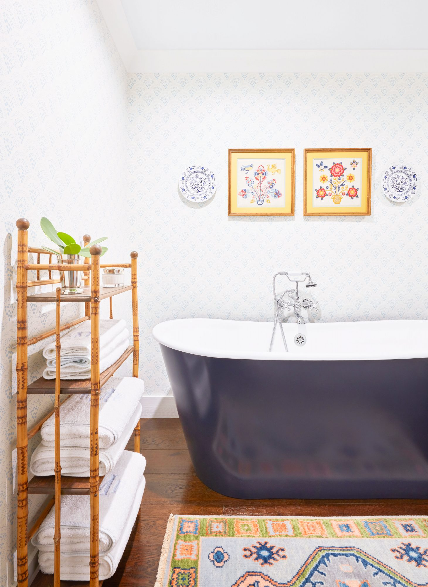 Pale Blue Bathroom with Navy Freestanding Tub