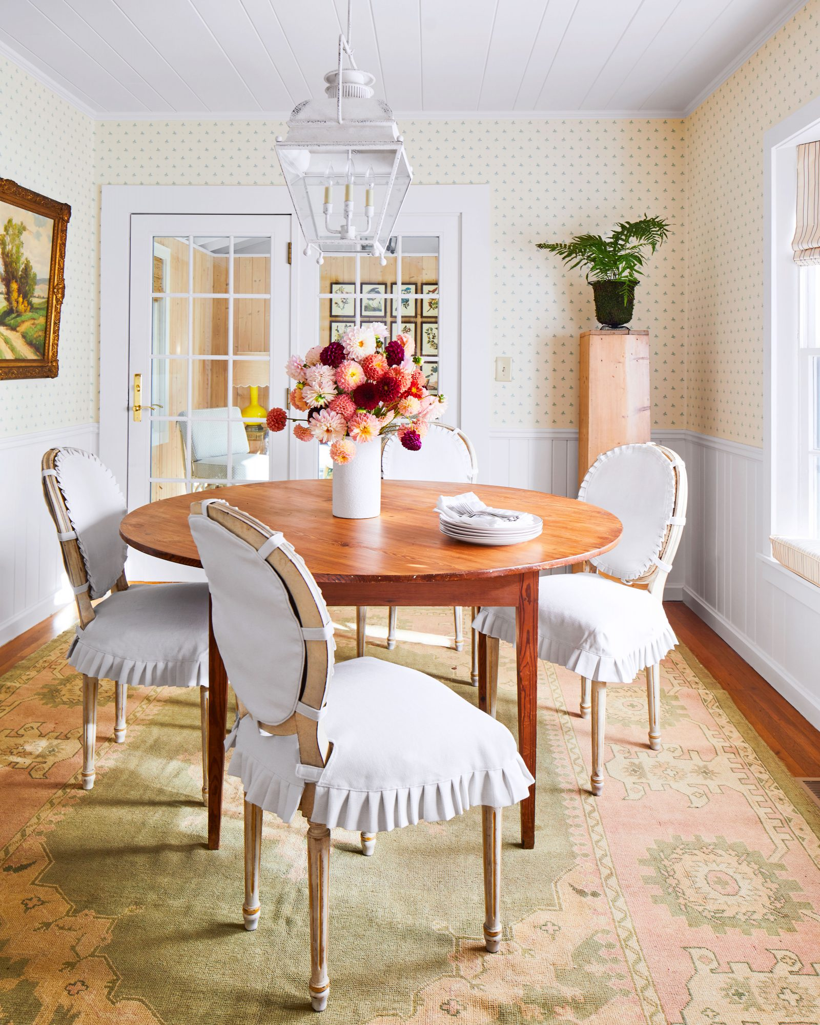 Mountain House Dining Room with French Inspired Chair Coverings