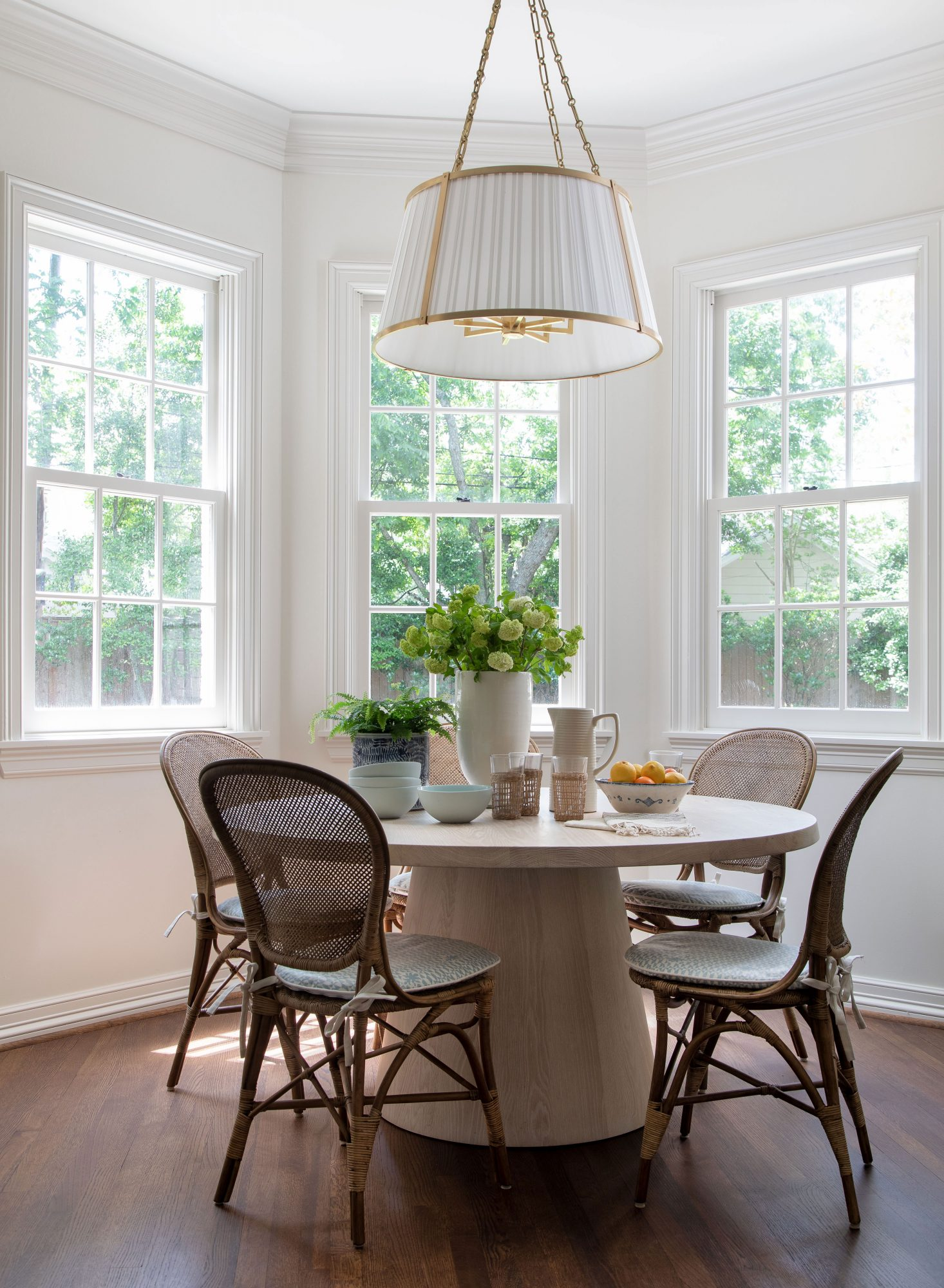 Breakfast nook with drum light fixture and round table