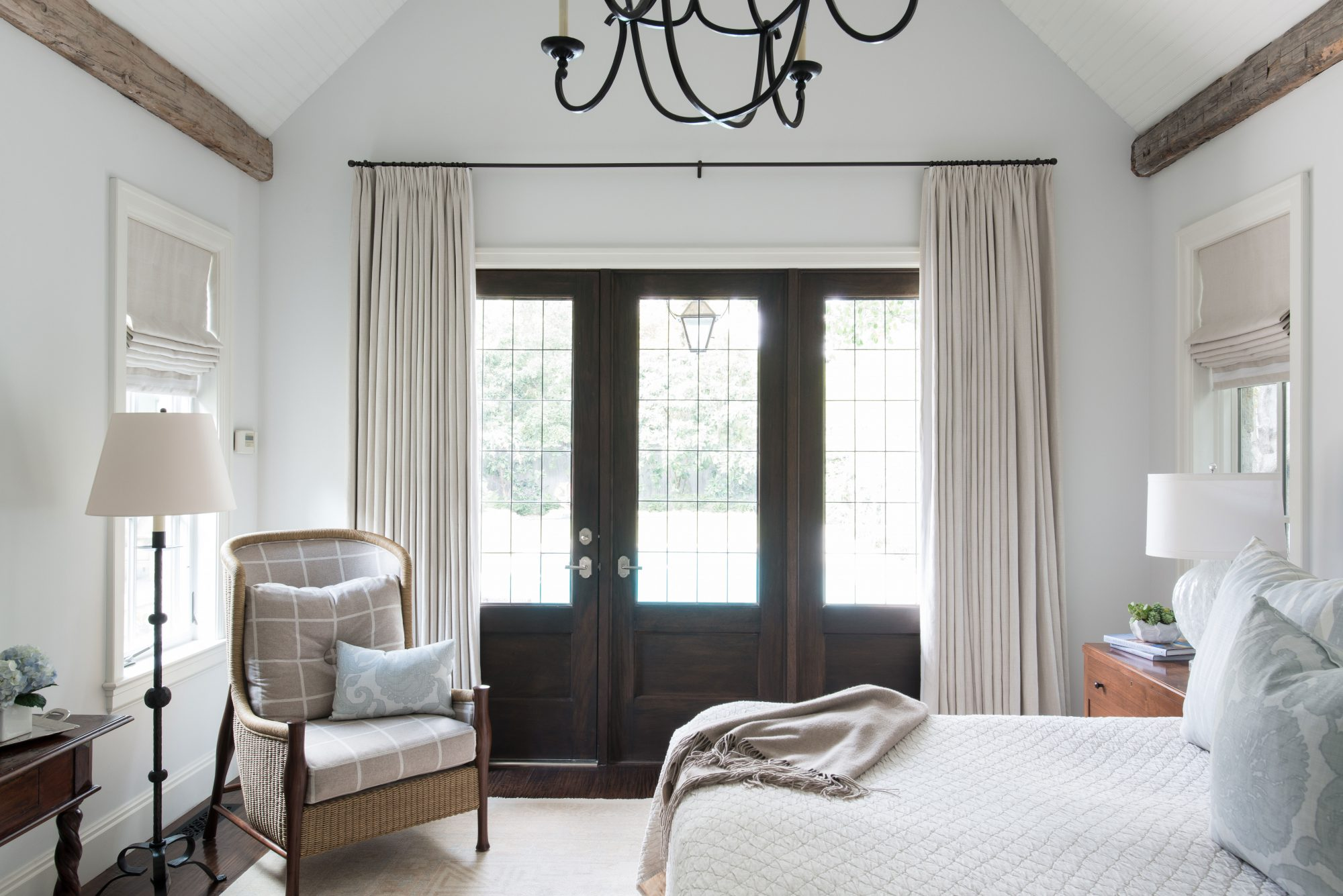 Large Bedroom with Vaulted Ceiling and Dark Wood French Doors