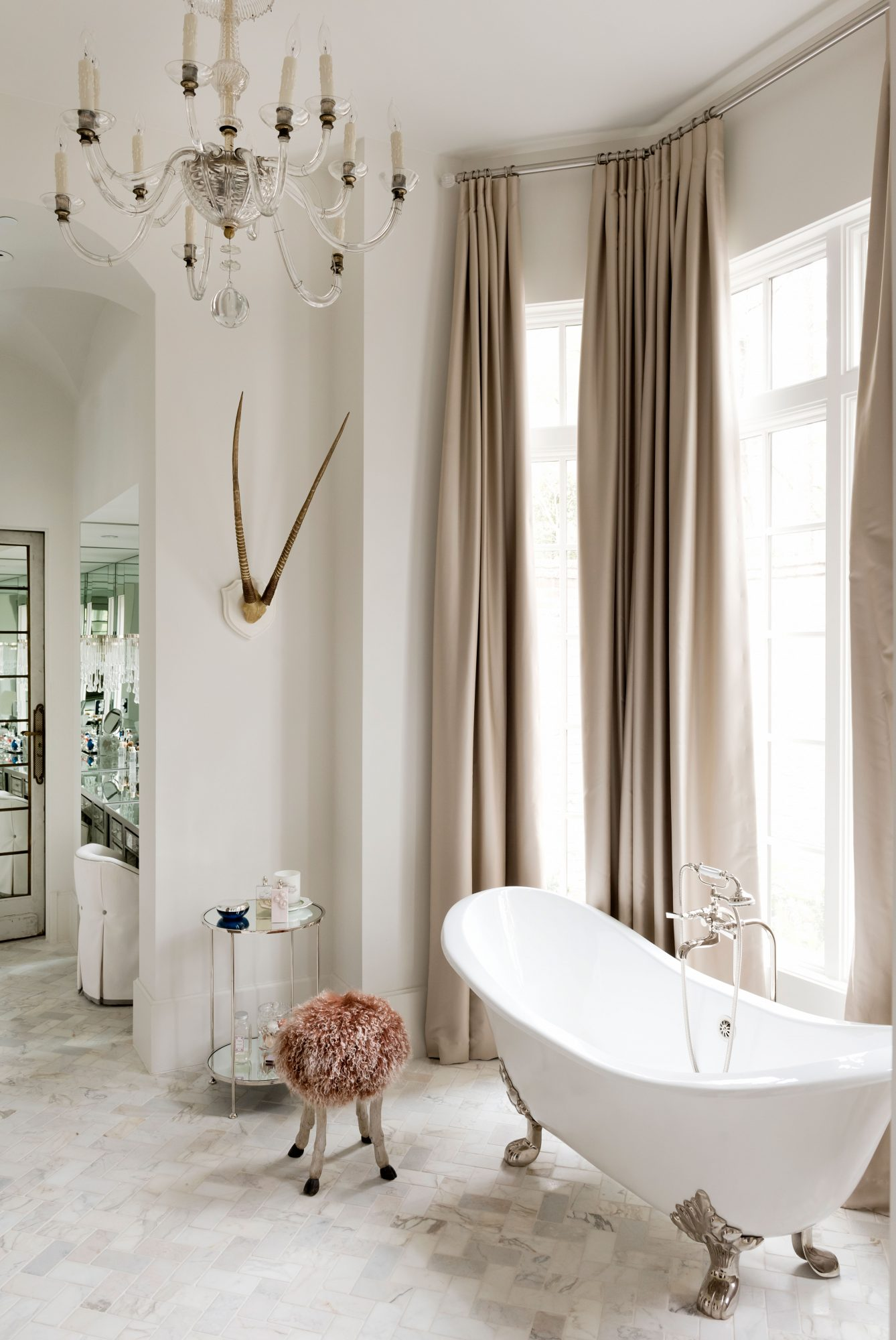 Soaking Tub in Front of Floor-to-Ceiling Windows with Draperies