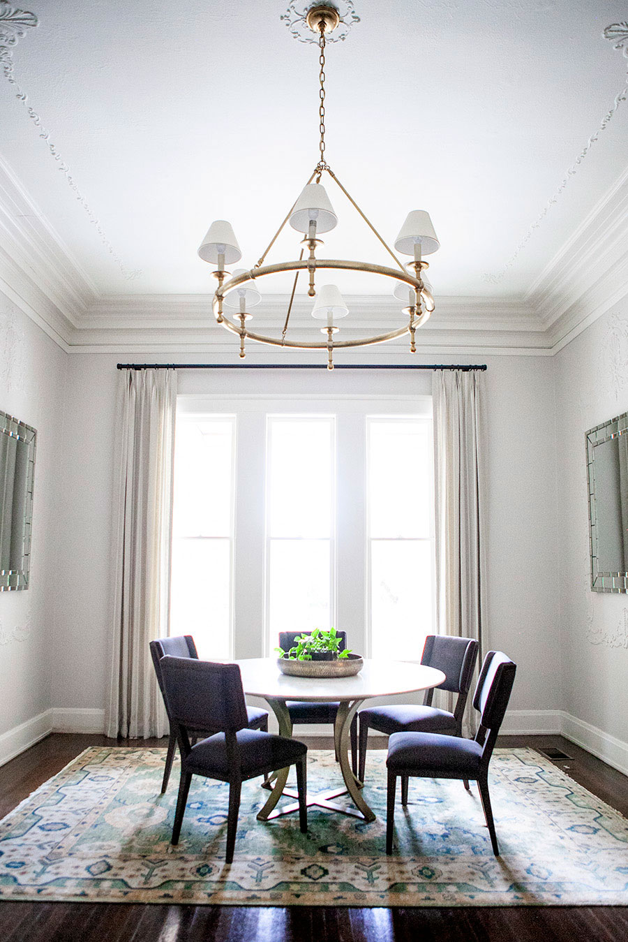 Dining Room with High Ceiling and Round Table