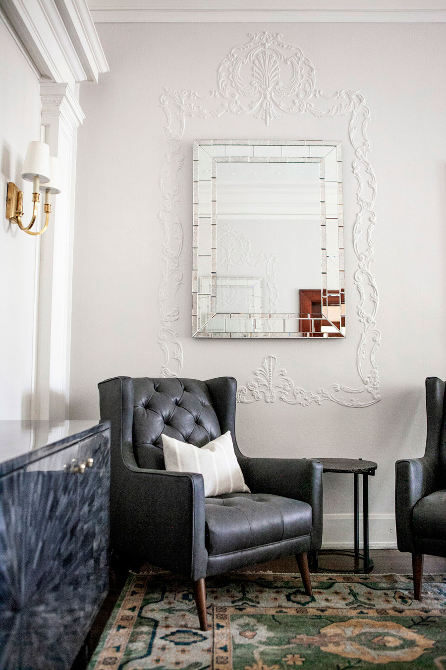 Sitting Area with Black Leather Chair
