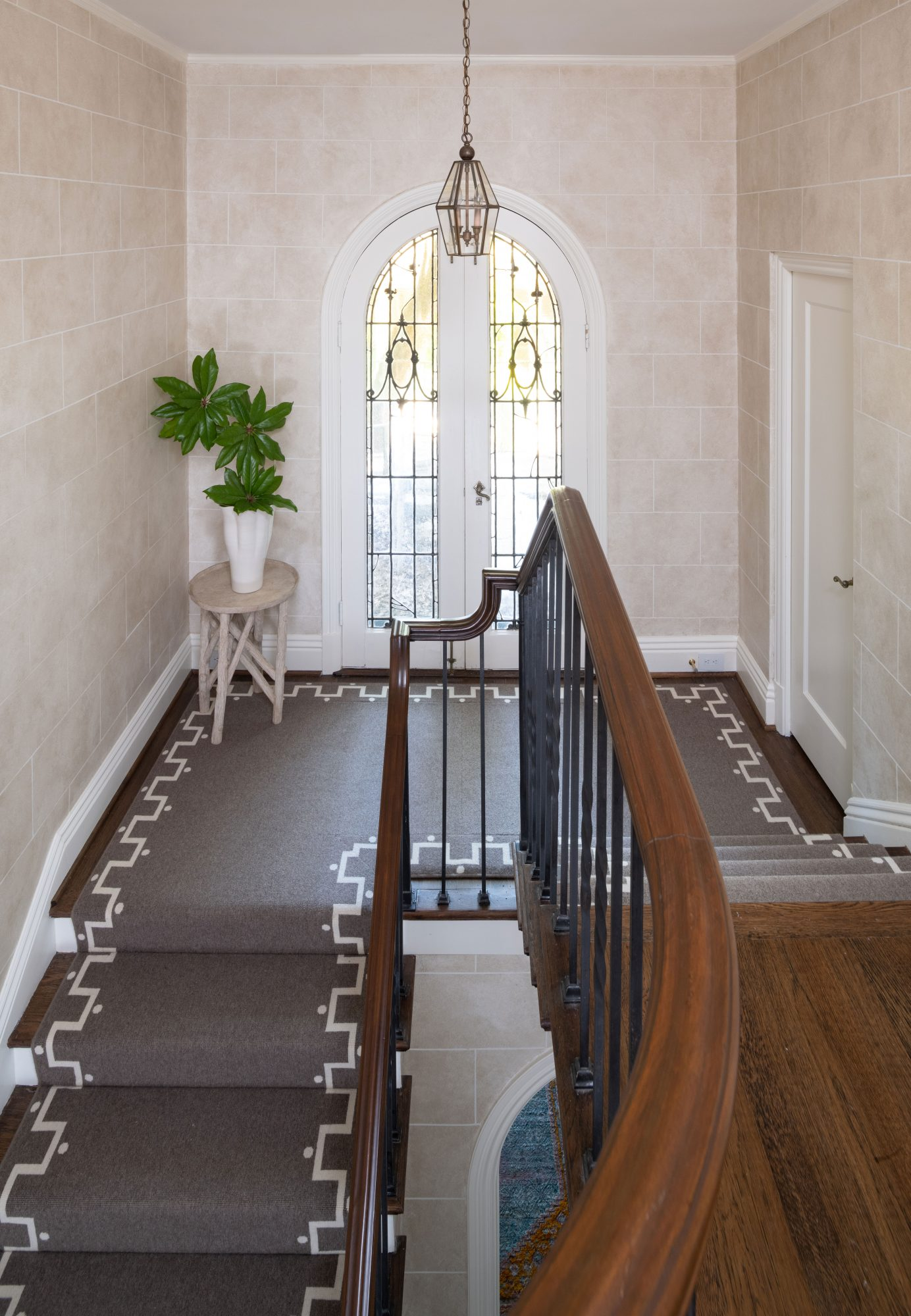 Elegant Staircase with French Doors and Stair Runner