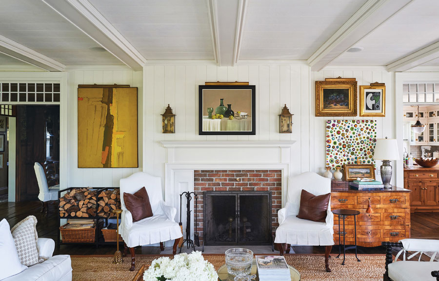 Historic Brick Fireplace with White Wood Paneling and Beamed Ceiling