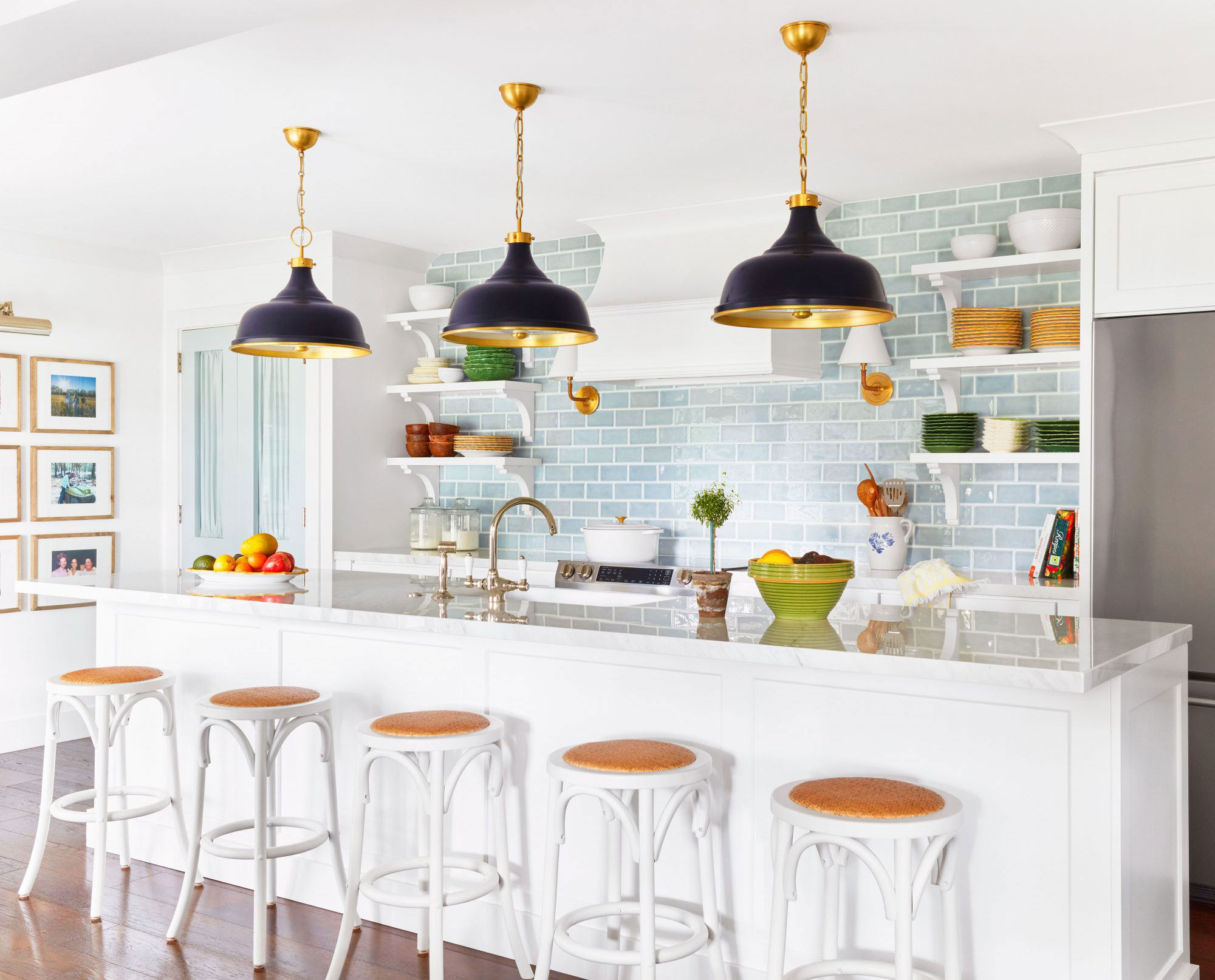 White Kitchen with Black Pendant Lights and Turquoise Subway Tile