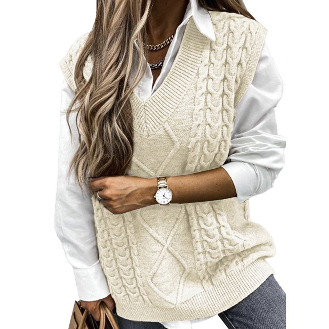 woman wearing cable knit sweater vest over white top