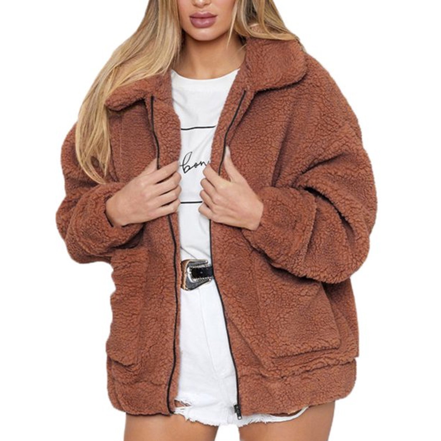 woman wearing brown teddy jacket, graphic tee, and white shorts