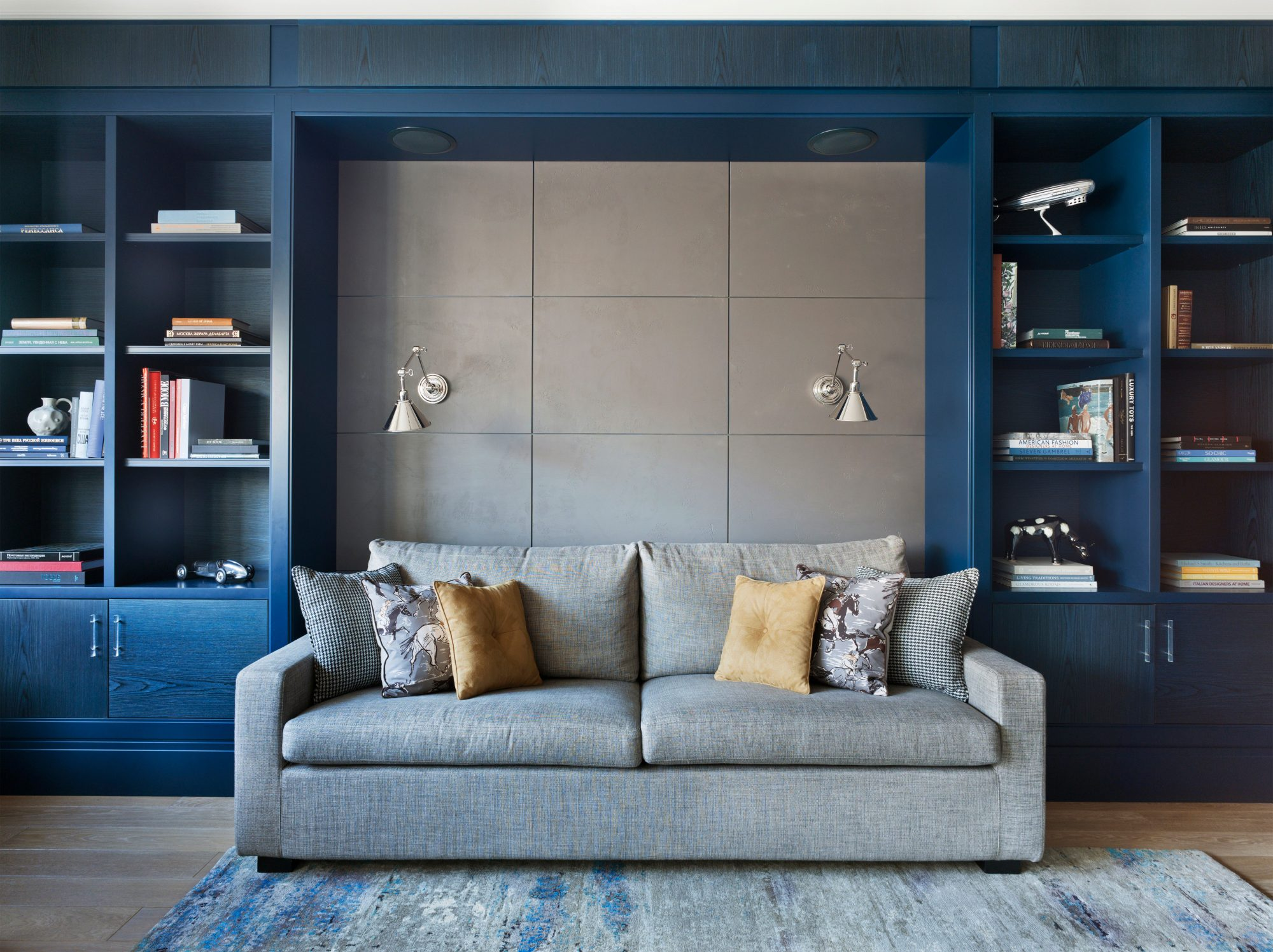 Couch Sitting in Front of Built-In Bookshelves