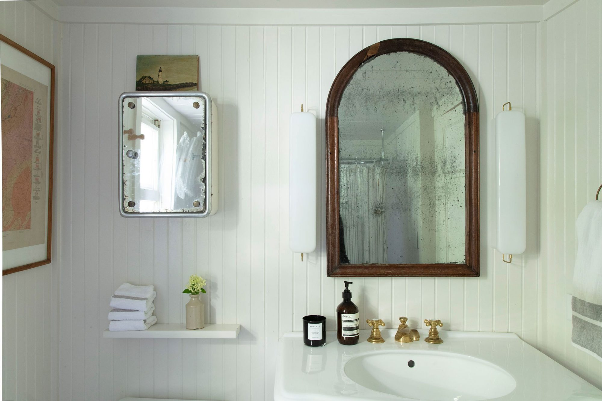 Powder Bath with Wood Paneling Painted White