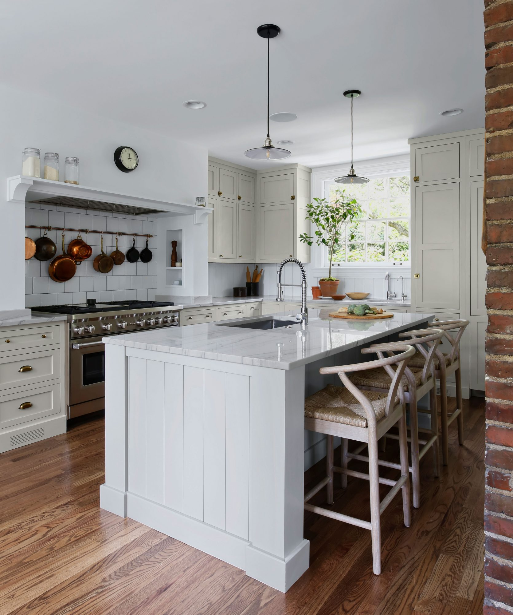Cottage Style Kitchen with Brick Wall, Island, and Wood Floors