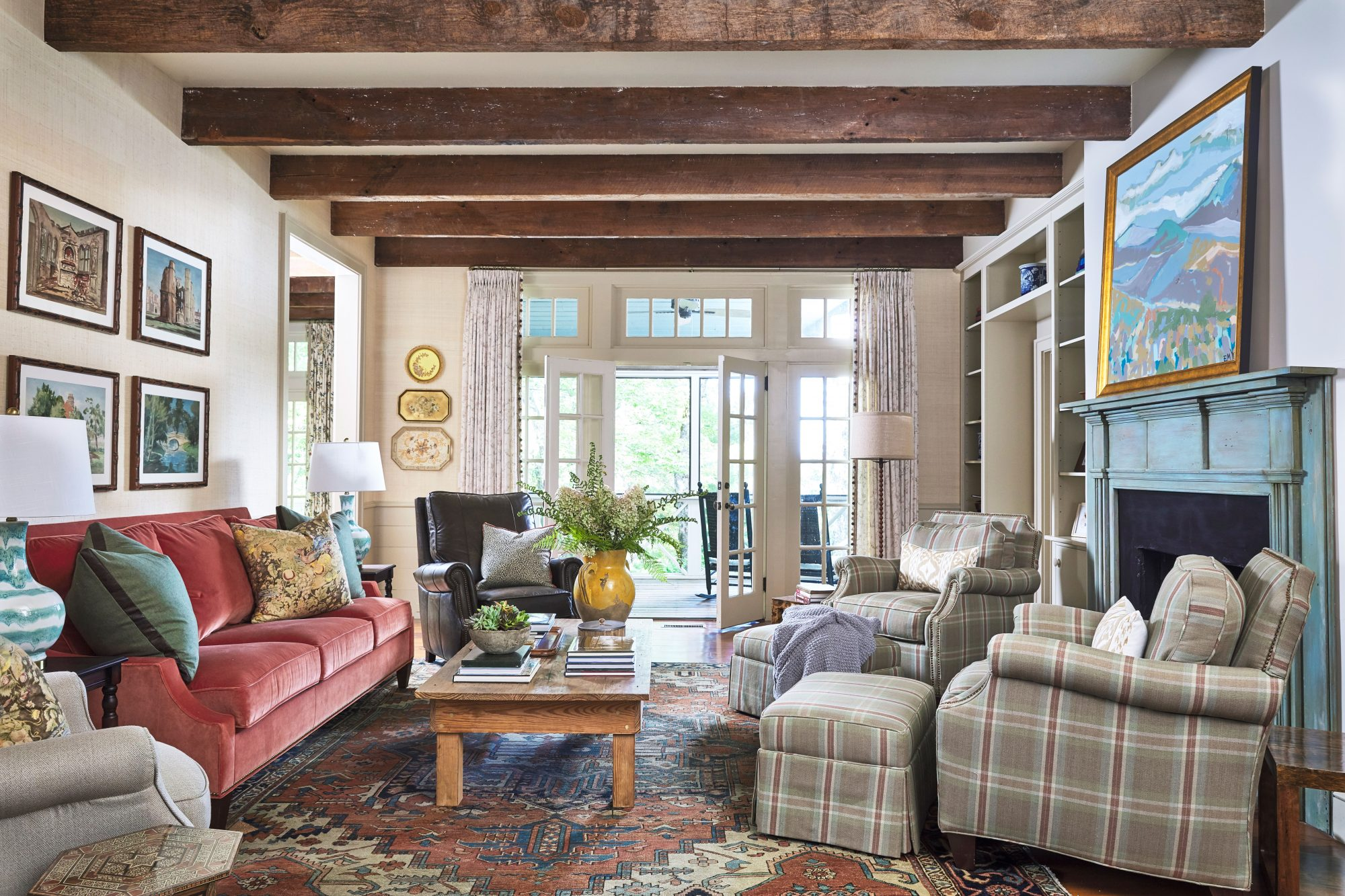 Mountain Cottage Living Room with Exposed Beams and Plaid Chairs