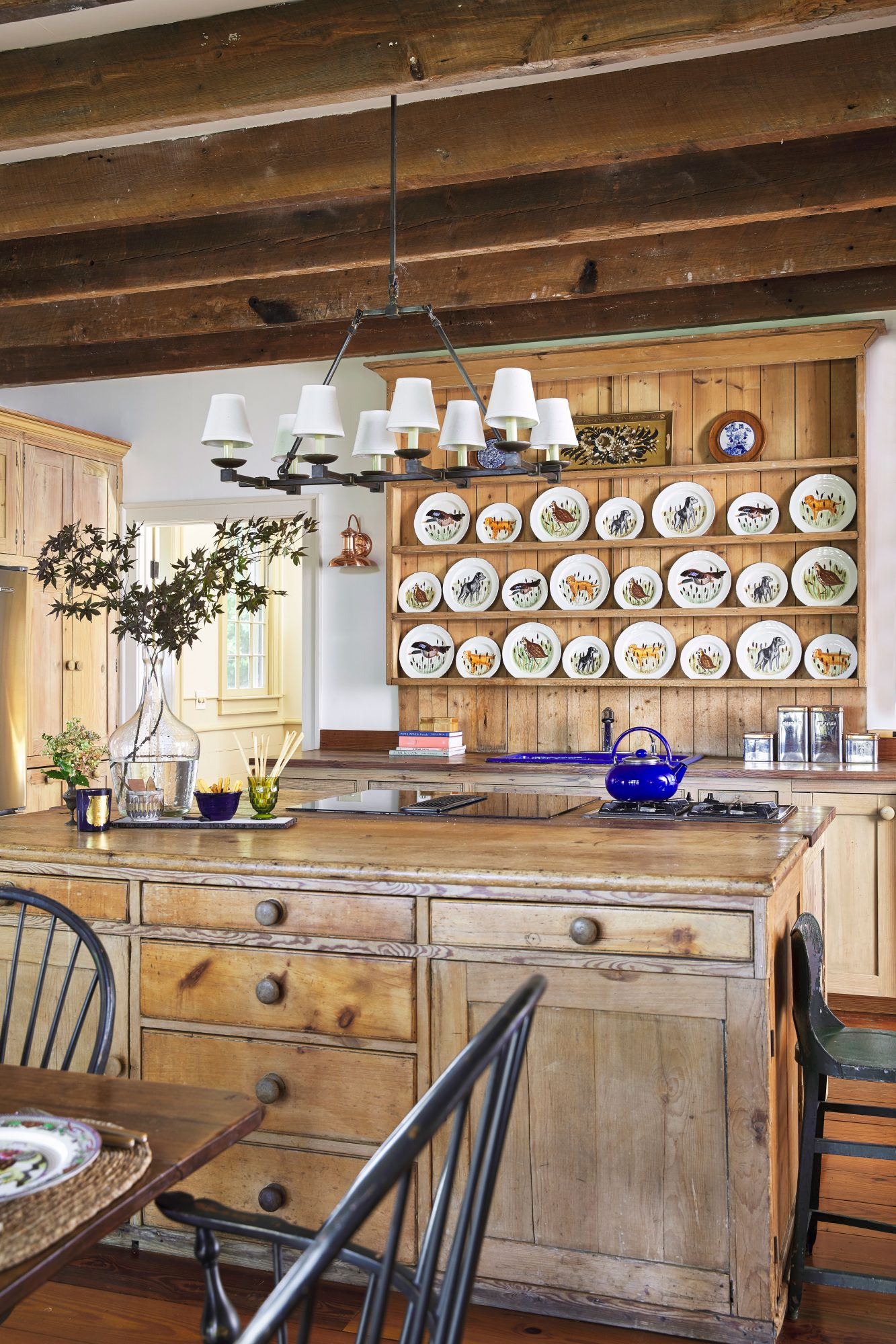 Cottage Kitchen with Wood Beams Overhead and Plate Collection