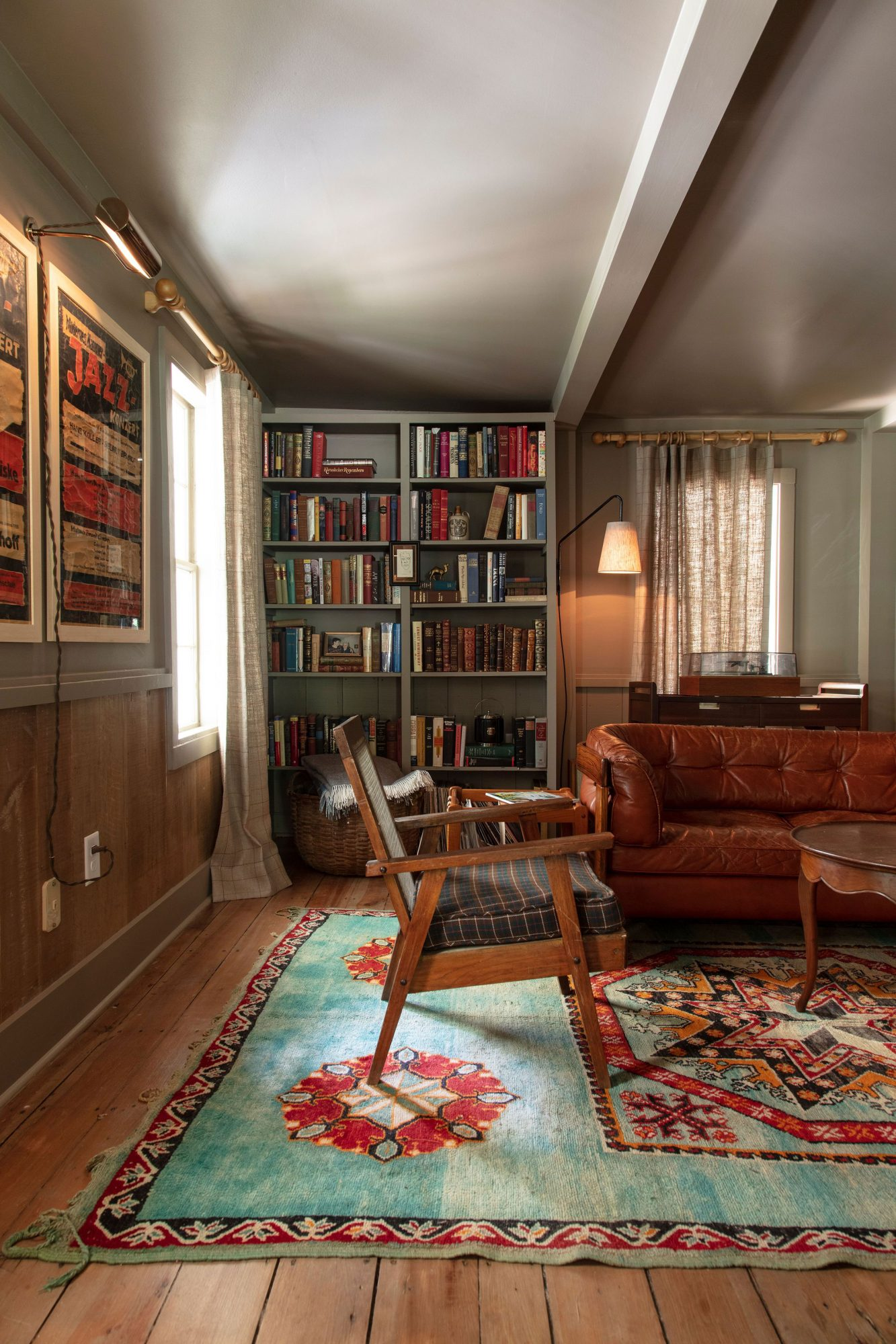 Home Office with Dark Paint and Built-In Bookshelves